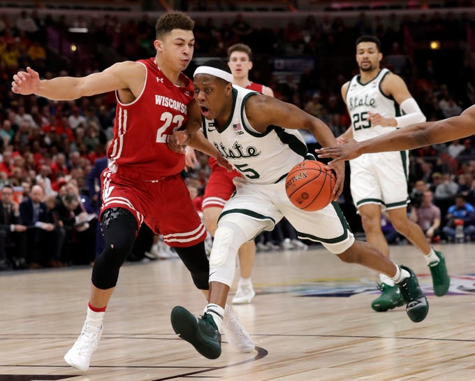 Michigan State's Cassius Winston (5) drives against Wisconsin's Kobe King (23) during the second half of an NCAA college basketball game in the semifinals of the Big Ten Conference tournament, Saturday, March 16, 2019, in Chicago.
