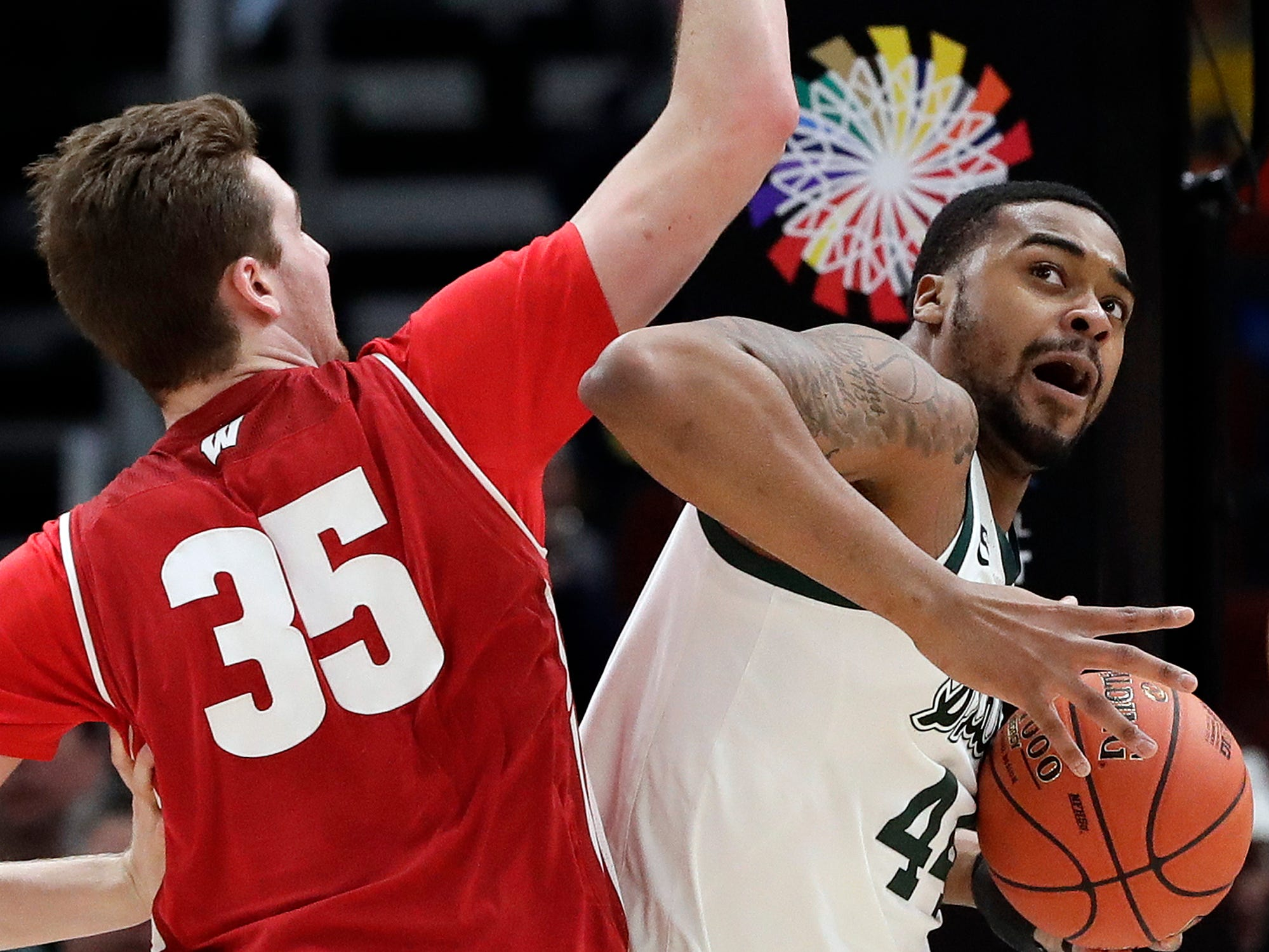 Michigan State's Nick Ward (44) drives against Wisconsin's Nate Reuvers (35) during the first half of an NCAA college basketball game in the semifinals of the Big Ten Conference tournament, Saturday, March 16, 2019, in Chicago.
