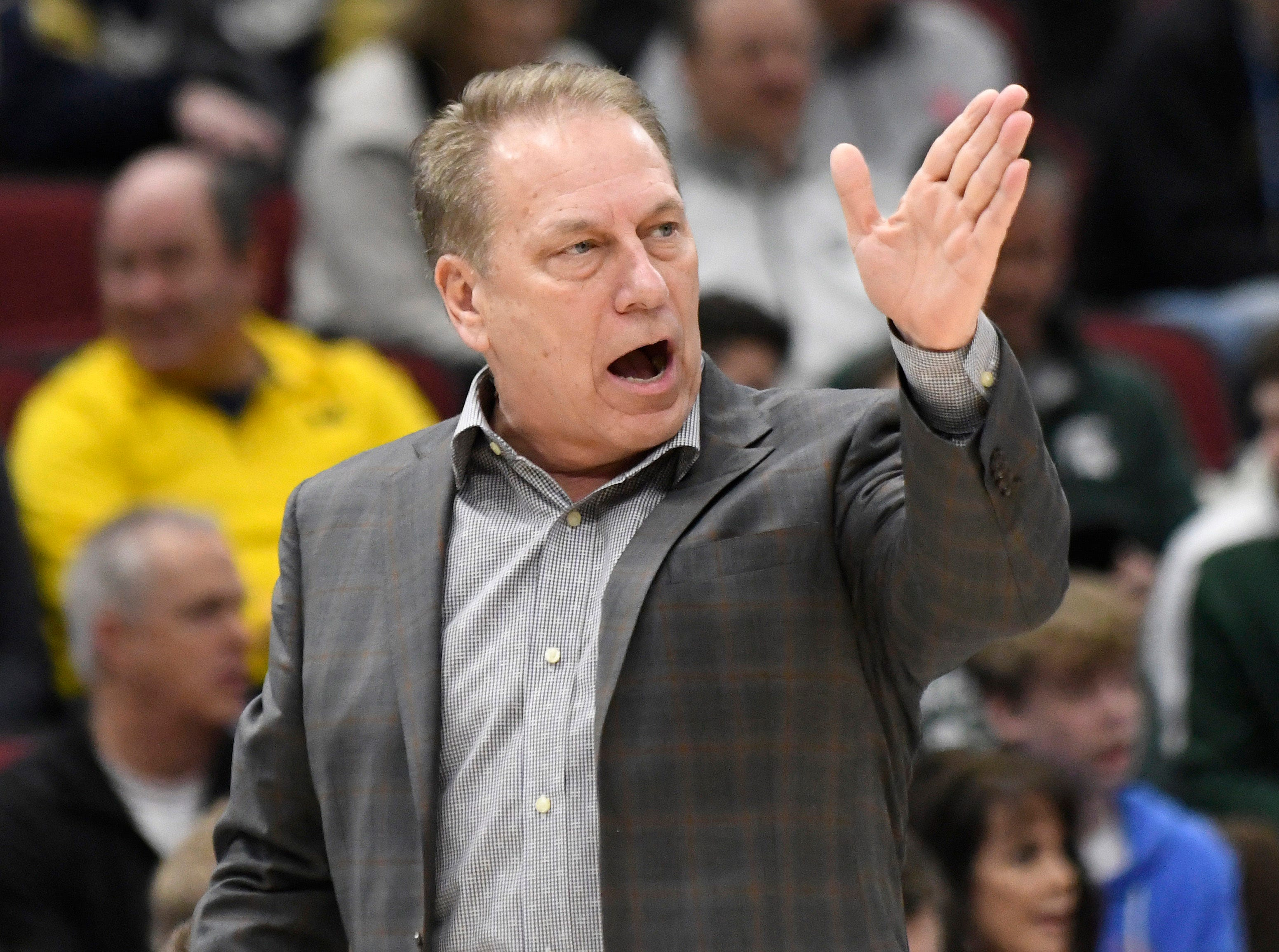 Michigan State Spartans head coach Tom Izzo gestures from the sidelines against the Wisconsin Badgers during the first half in the Big Ten conference tournament at United Center.
