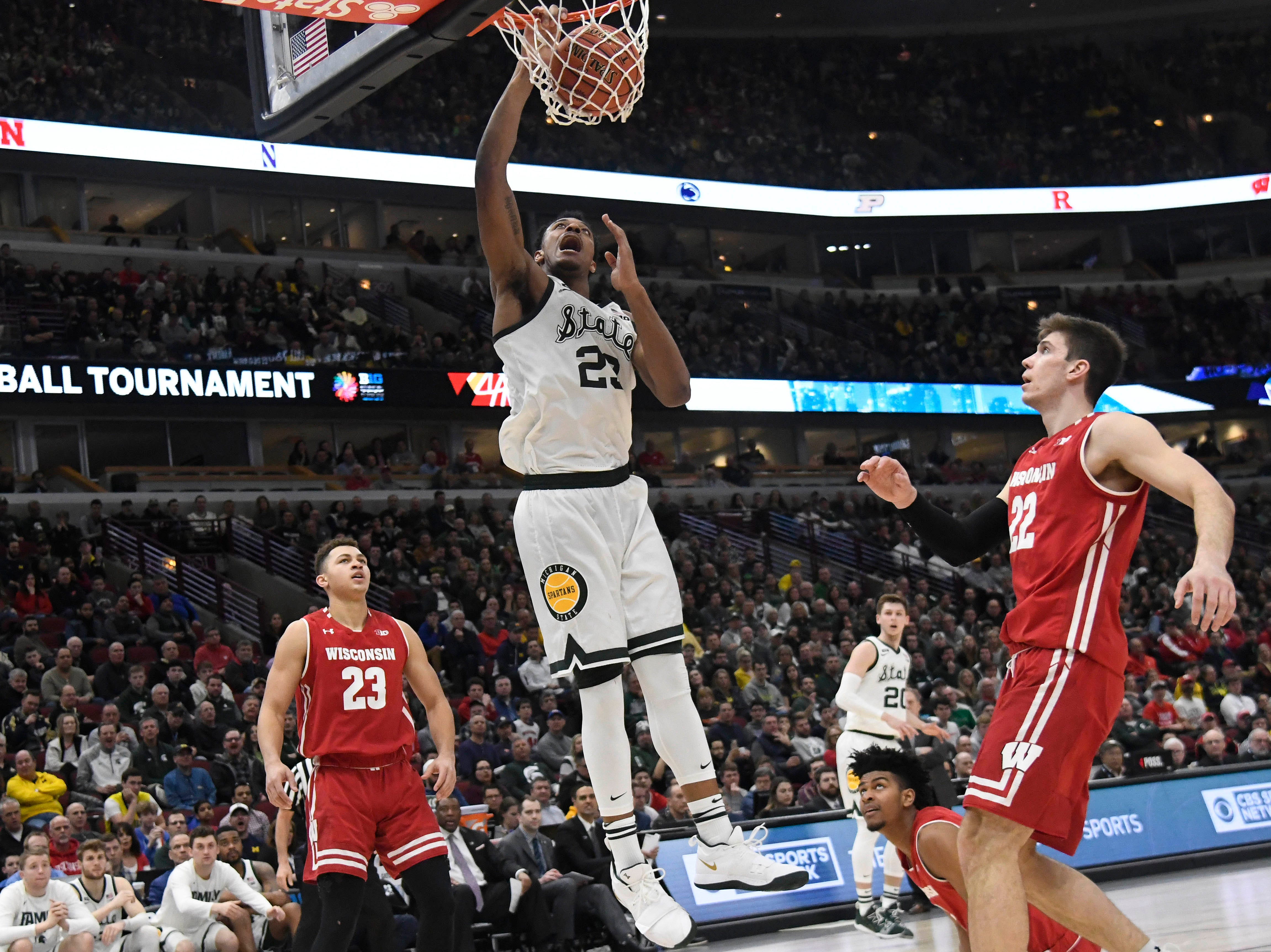 Michigan State Spartans forward Xavier Tillman (23) dunks the ball against the Wisconsin Badgers during the second half in the Big Ten conference tournament at United Center.