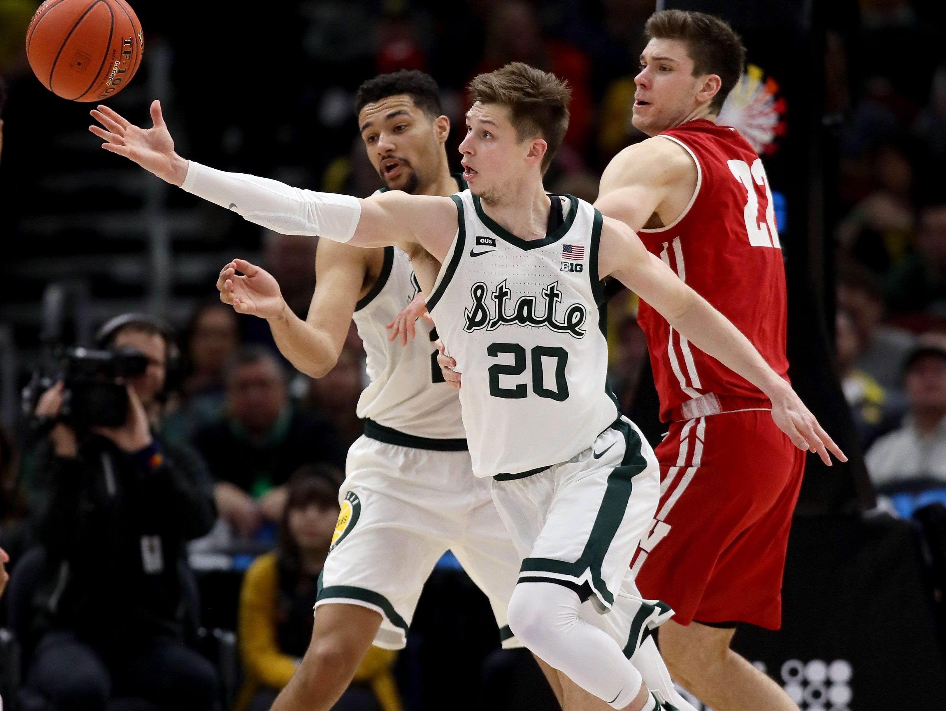 Matt McQuaid #20 of the Michigan State Spartans reaches for a loose ball in the second half against the Wisconsin Badgers during the semifinals of the Big Ten Basketball Tournament at the United Center on March 16, 2019 in Chicago, Illinois.