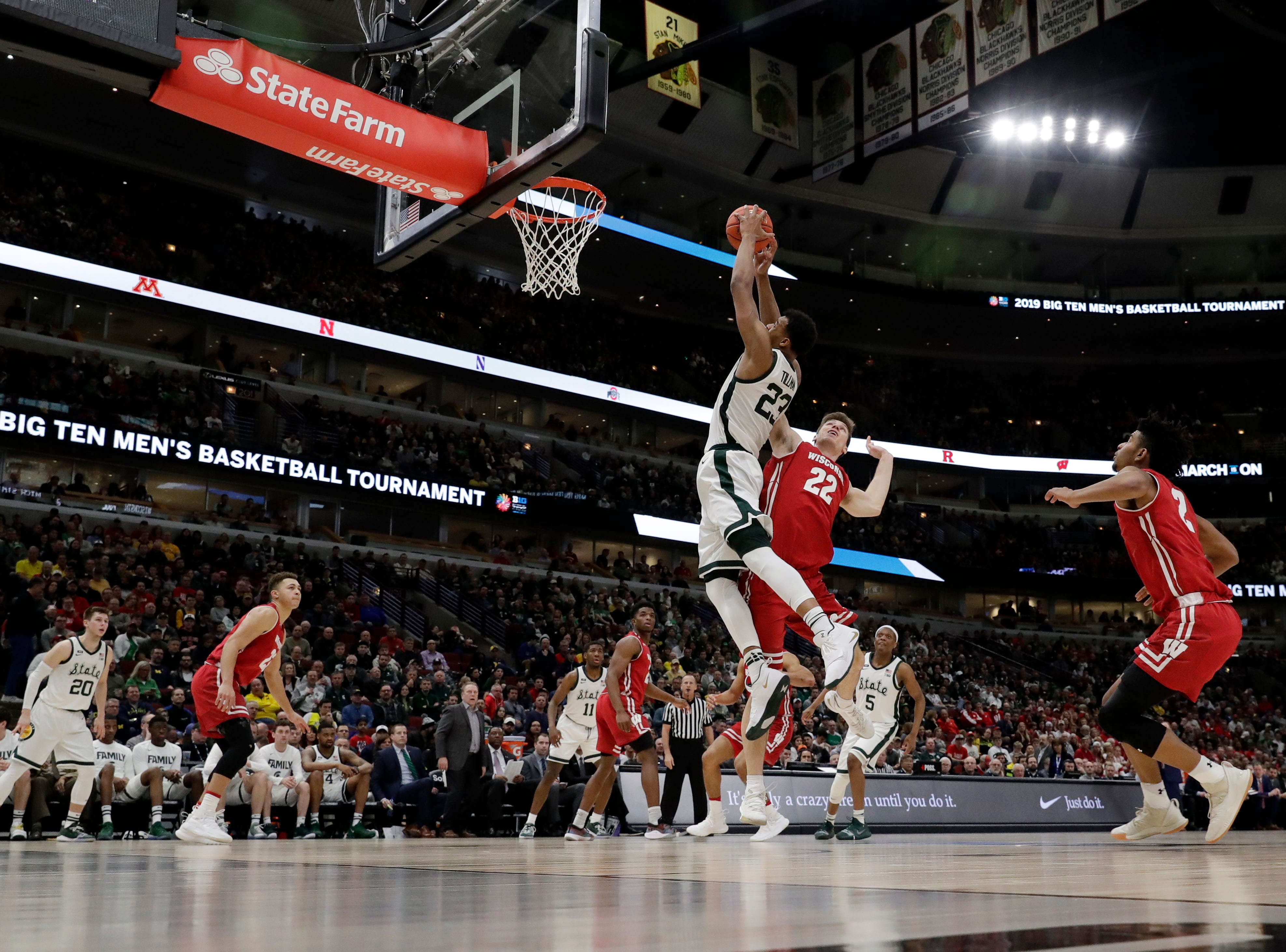 Michigan State's Xavier Tillman (23) grabs a rebound over Wisconsin's Ethan Happ (22) during the second half of an NCAA college basketball game in the semifinals of the Big Ten Conference tournament, Saturday, March 16, 2019, in Chicago.