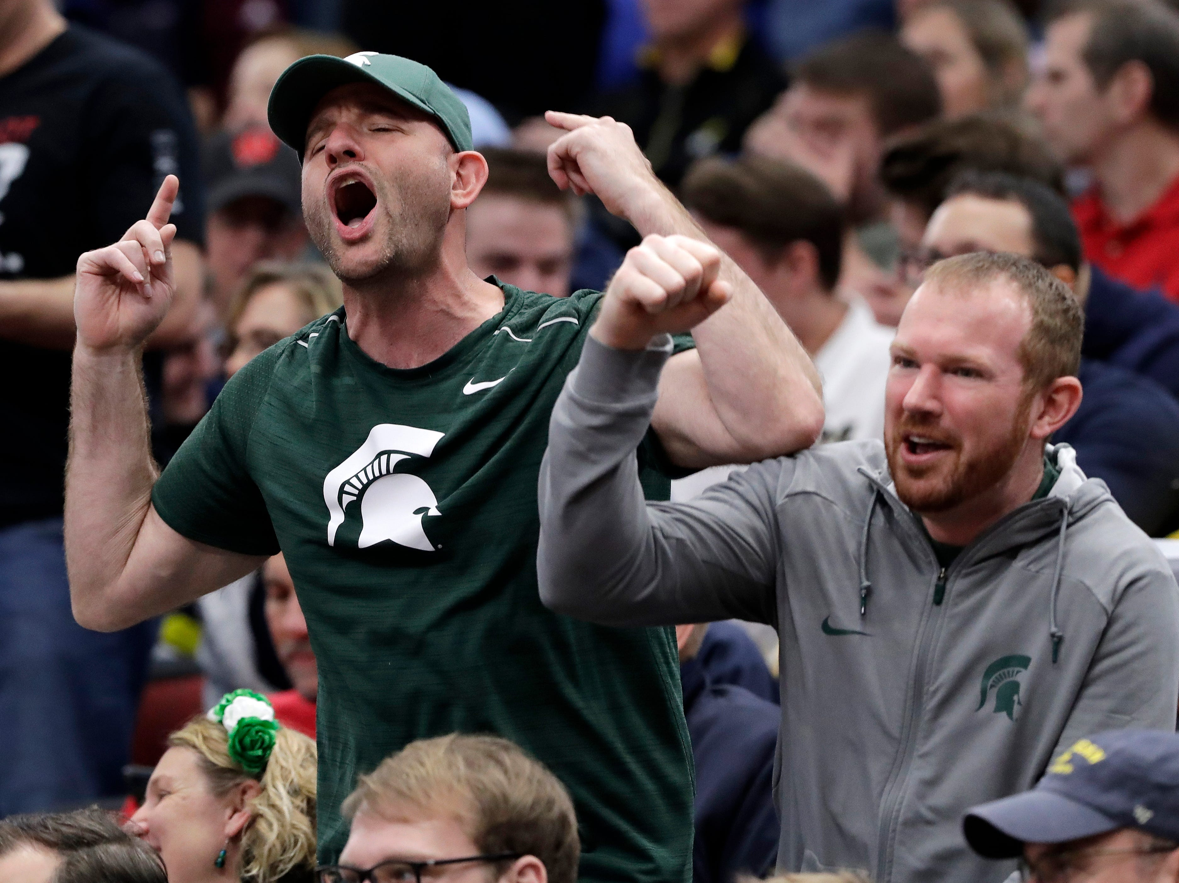 Michigan State fans cheer during the second half of an NCAA college basketball game between Michigan State and Wisconsin in the semifinals of the Big Ten Conference tournament, Saturday, March 16, 2019, in Chicago. Michigan State won 67-55.