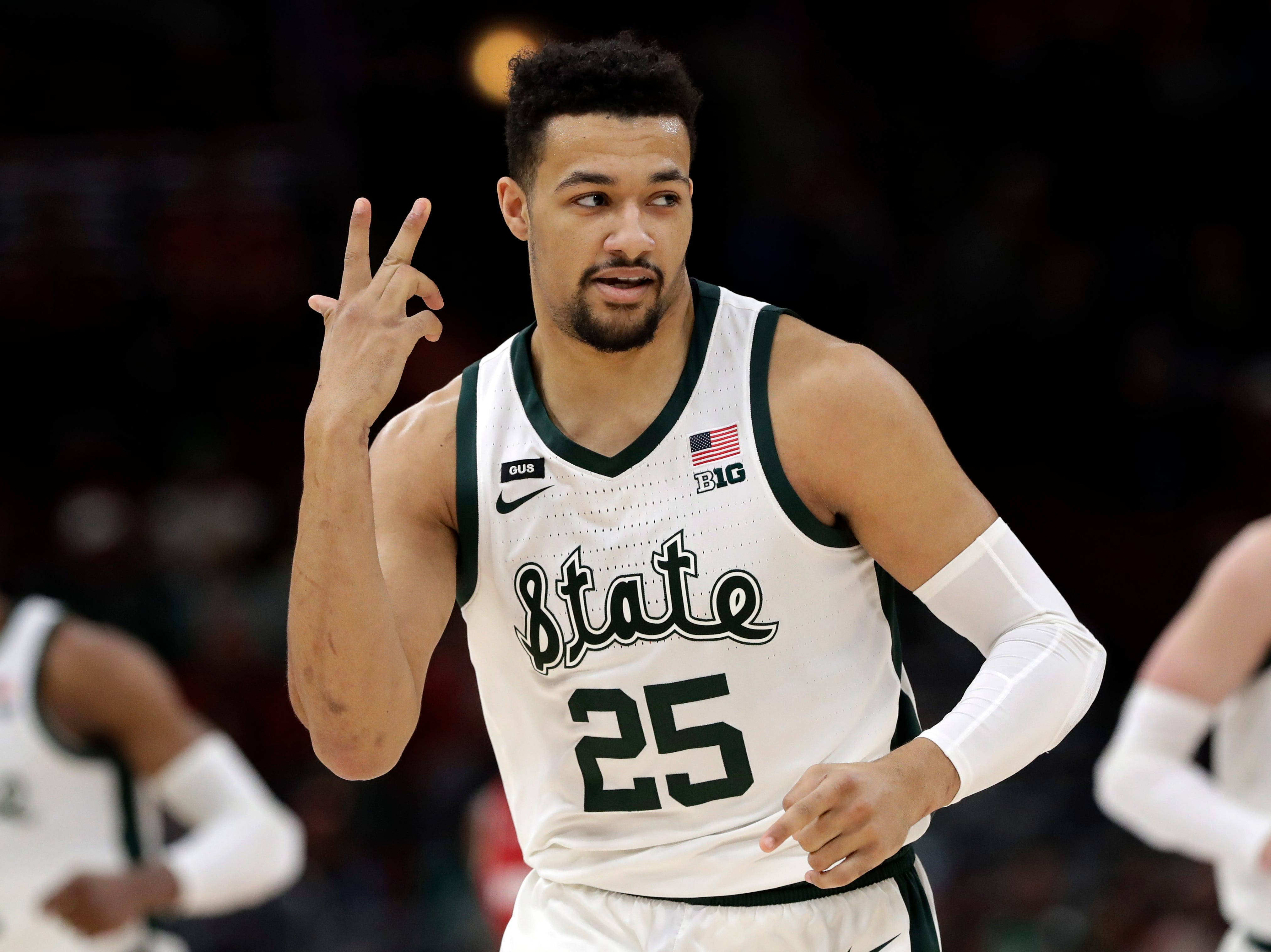 Michigan State's Kenny Goins (25) reacts after shooting a 3-point basket during the first half of an NCAA college basketball game against Wisconsin in the semifinals of the Big Ten Conference tournament, Saturday, March 16, 2019, in Chicago.