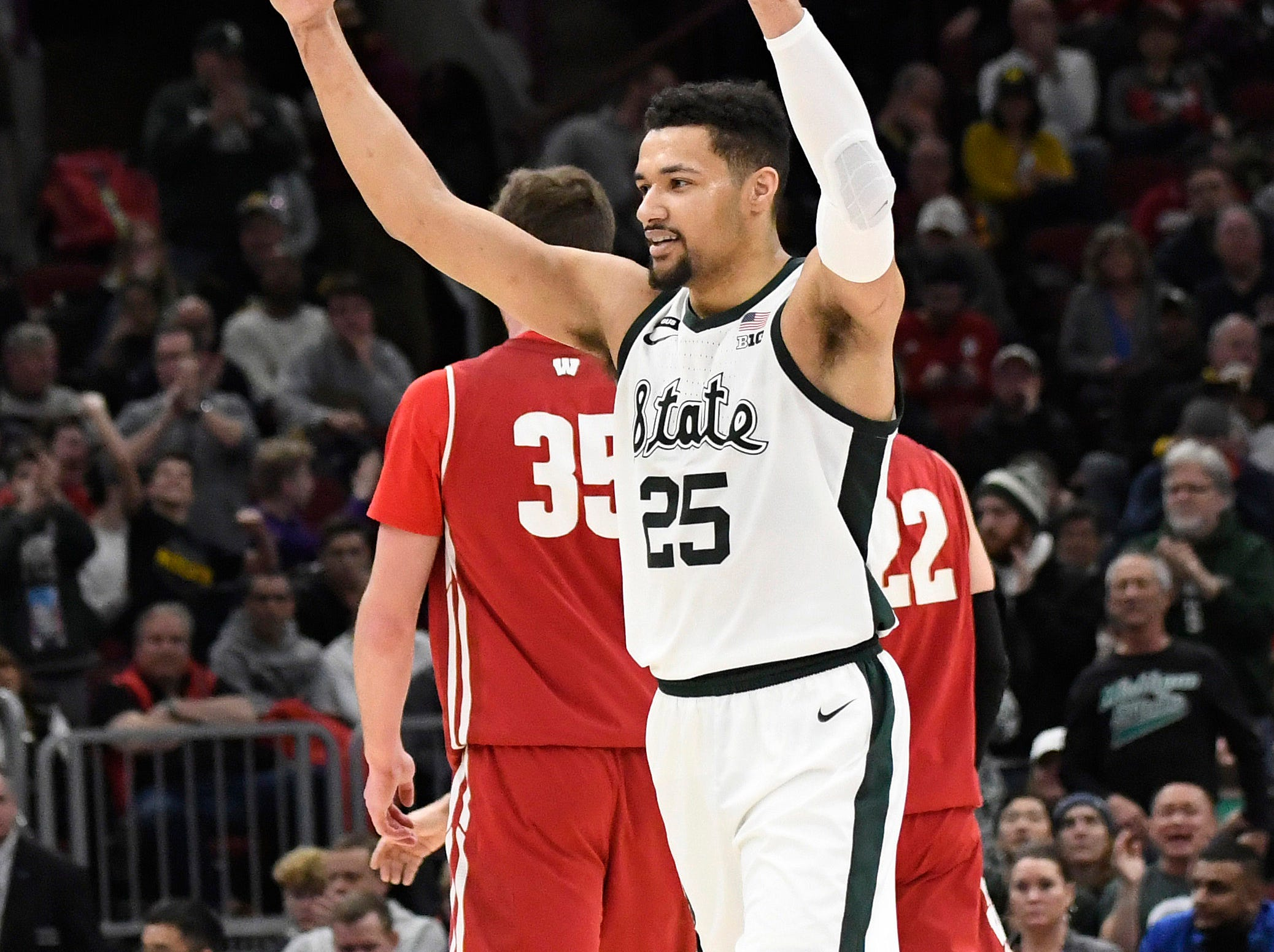 Michigan State Spartans forward Kenny Goins (25) reacts after a play against the Wisconsin Badgers during the second half in the Big Ten conference tournament at United Center.
