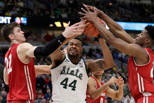 Michigan State's Nick Ward (44) battles for a rebound against Wisconsin's Ethan Happ (22) and Aleem Ford (2) during the second half of an NCAA college basketball game in the semifinals of the Big Ten Conference tournament, Saturday, March 16, 2019, in Chicago. Michigan State won 67-55.
