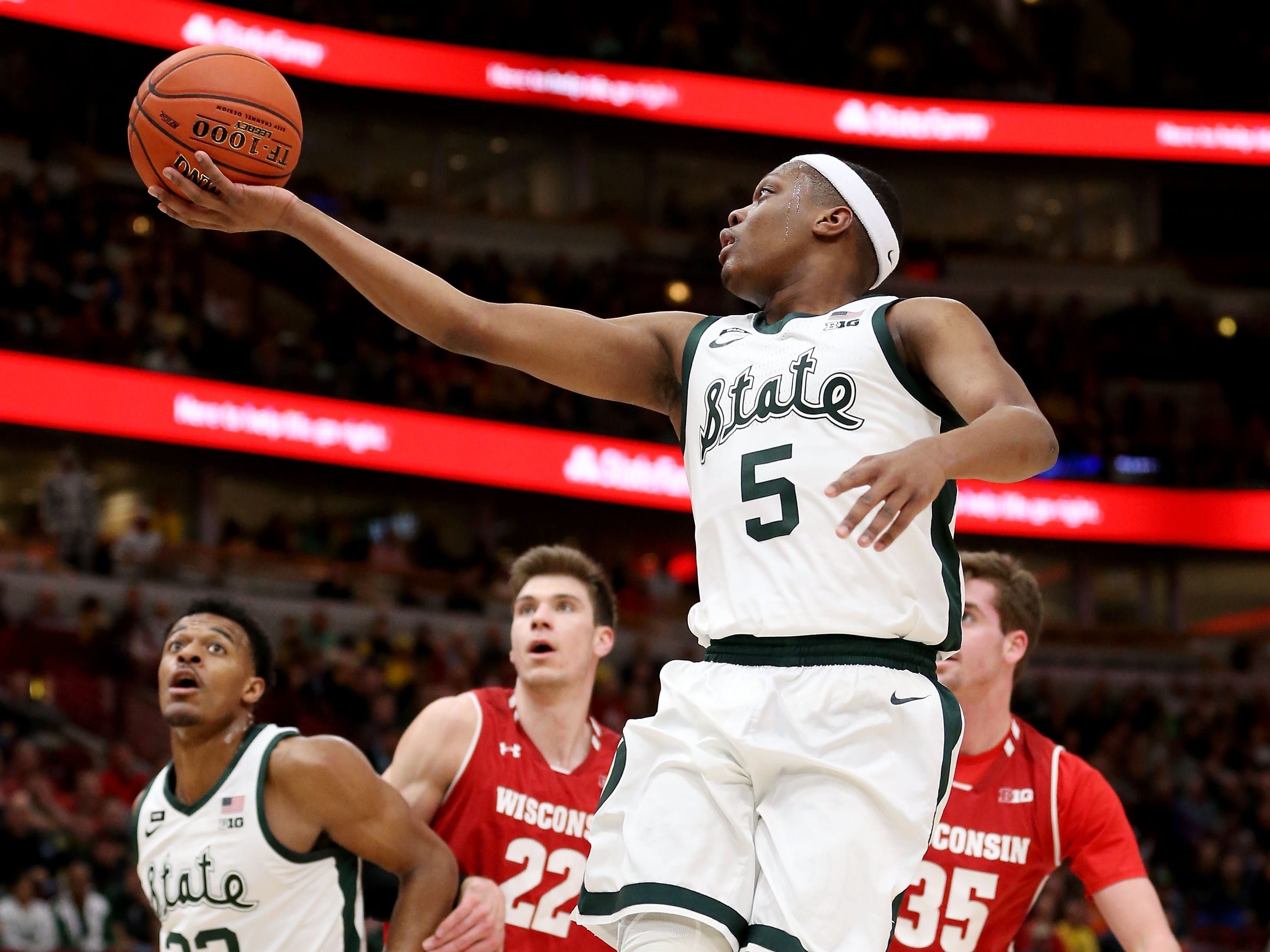 Cassius Winston #5 of the Michigan State Spartans attempts a shot in the first half against the Wisconsin Badgers during the semifinals of the Big Ten Basketball Tournament at the United Center on March 16, 2019 in Chicago, Illinois.