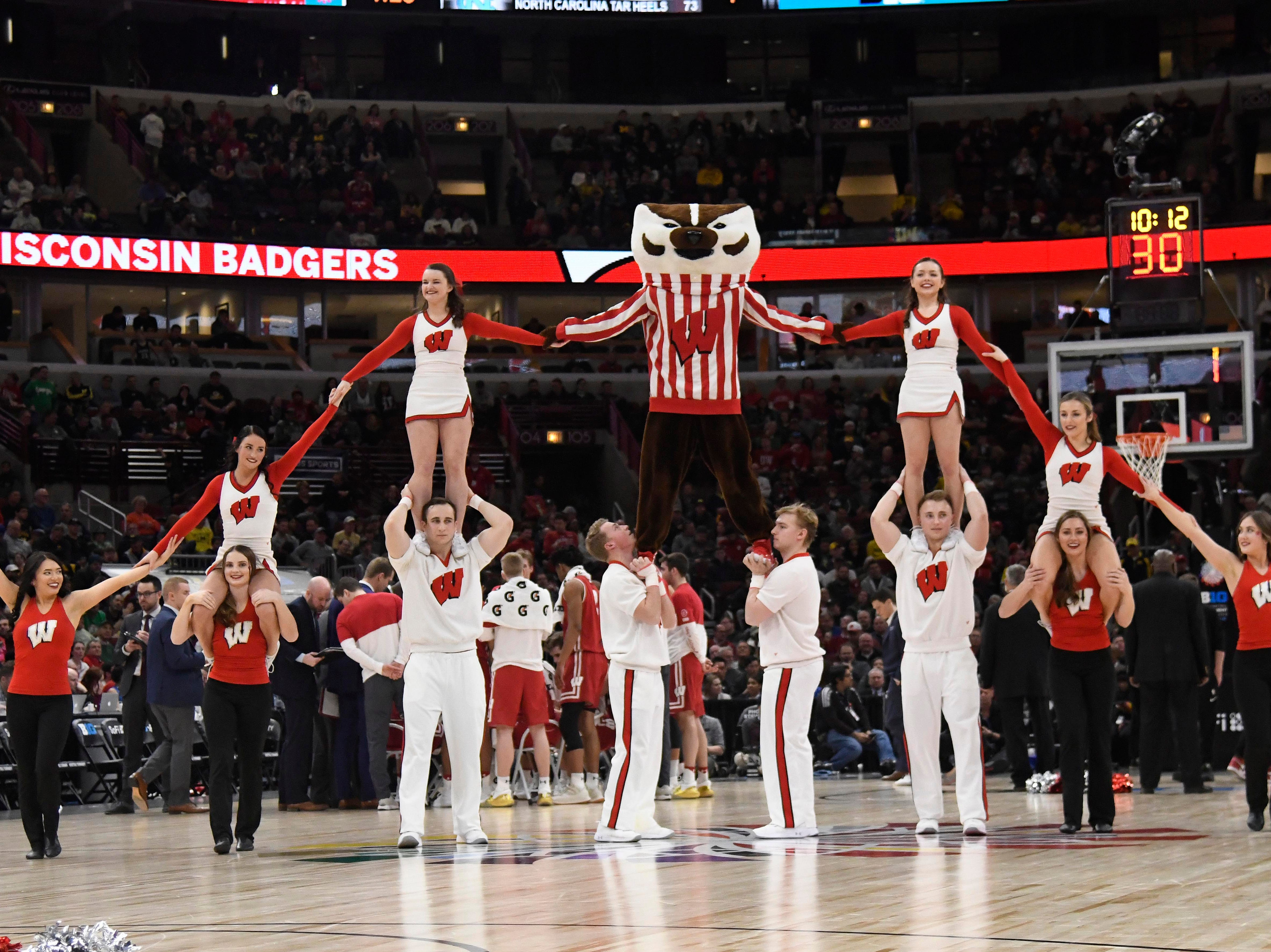 The Wisconsin Badgers cheerleaders perform during a stoppage in play in the second half in the Big Ten conference tournament against the Michigan State Spartans at United Center.