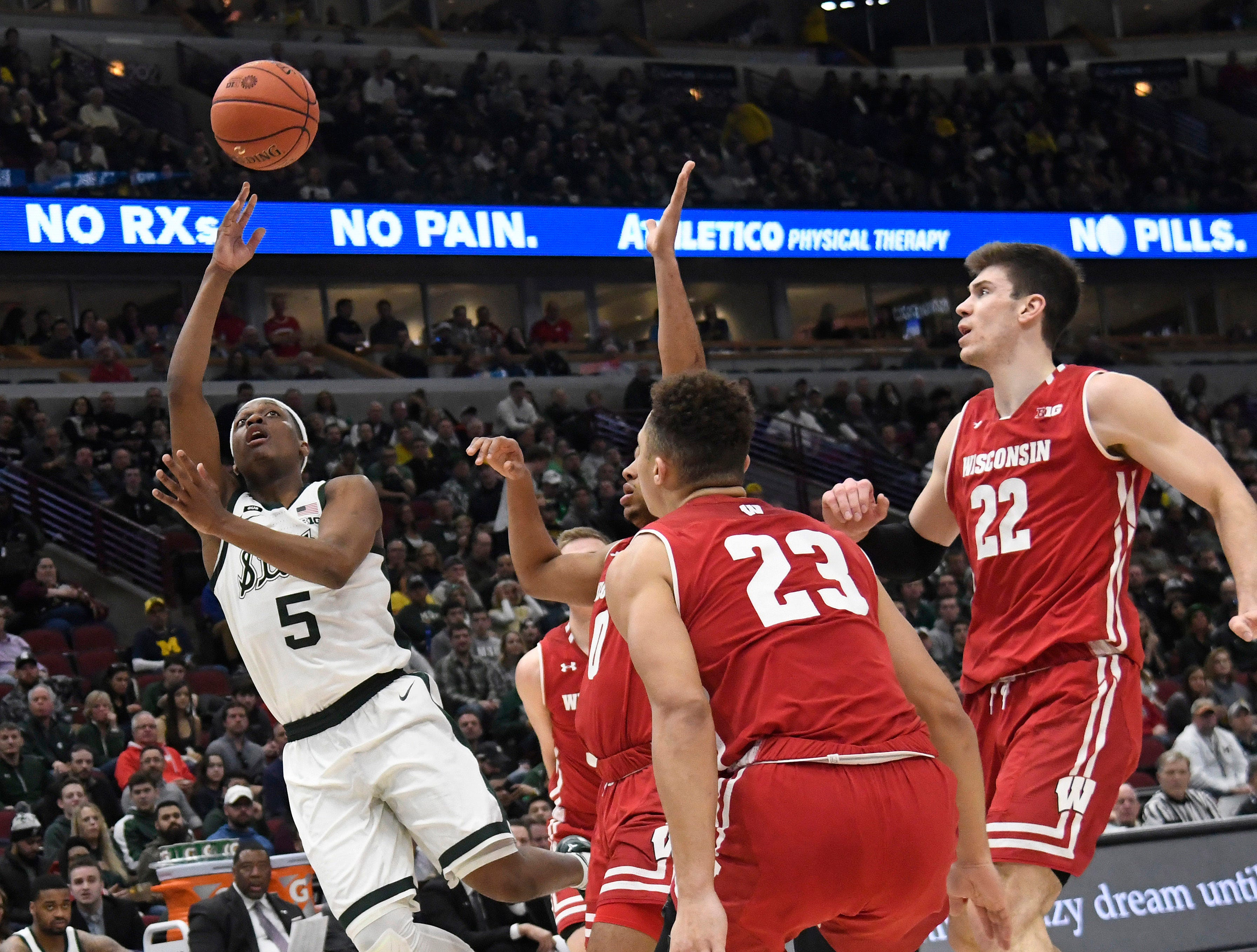Michigan State Spartans guard Cassius Winston (5) shoots the ball against the Wisconsin Badgers during the second half in the Big Ten conference tournament at United Center.