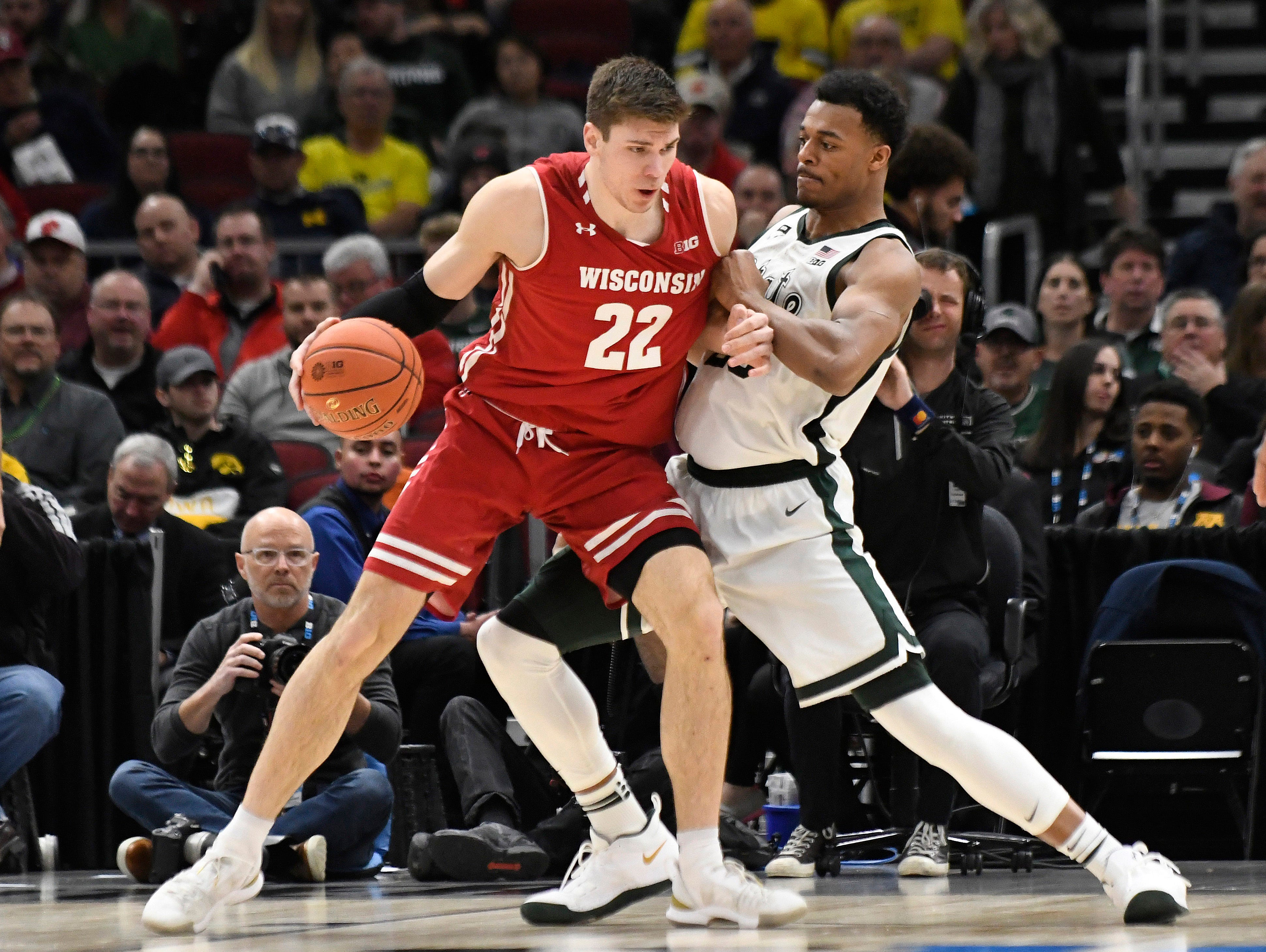 Wisconsin Badgers forward Ethan Happ (22) controls the ball as Michigan State Spartans forward Xavier Tillman (23) defends during the second half in the Big Ten conference tournament at United Center.