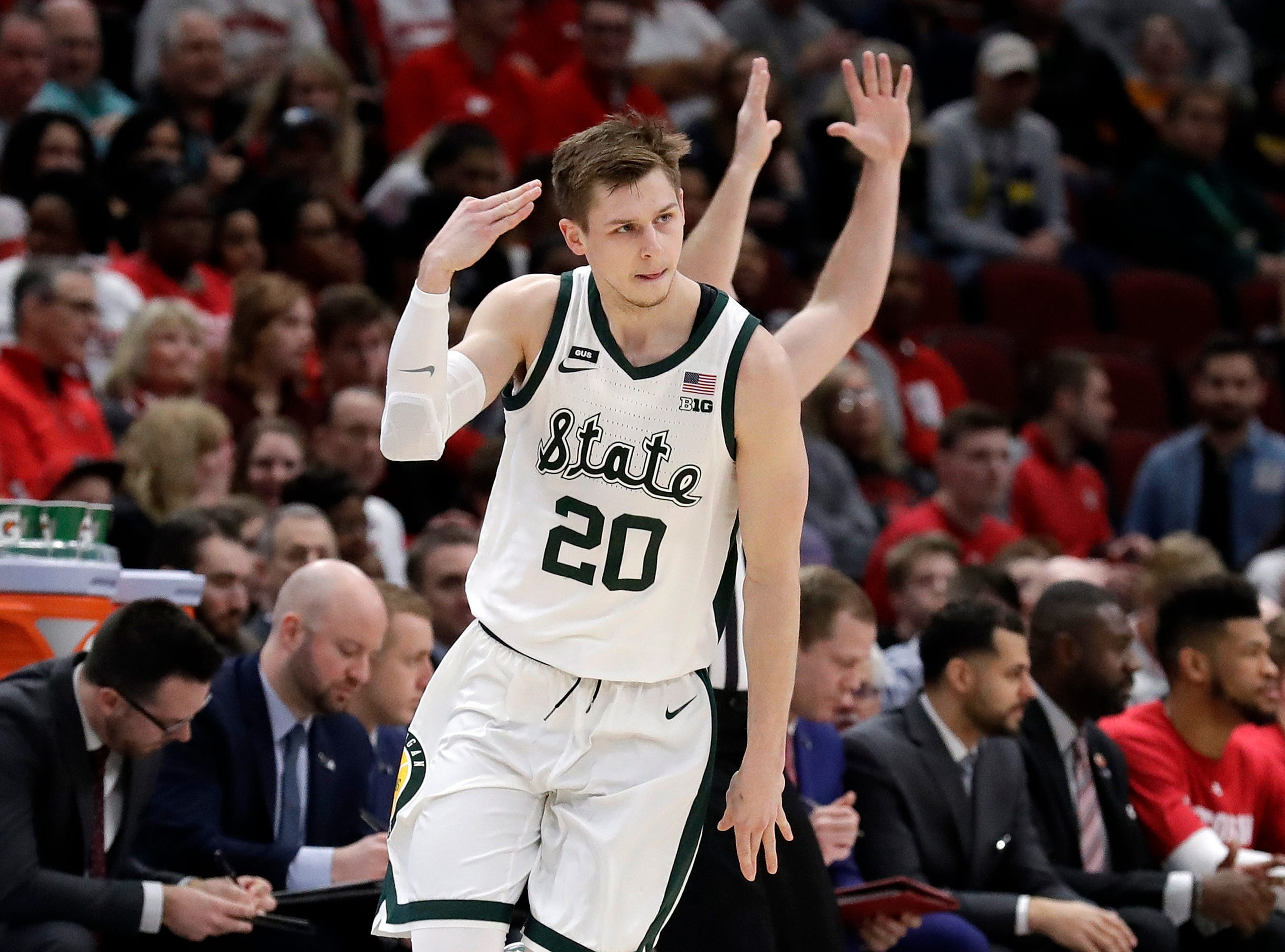 Michigan State's Matt McQuaid (20) reacts after shooting a 3-point basket during the first half of an NCAA college basketball game against Wisconsin in the semifinals of the Big Ten Conference tournament, Saturday, March 16, 2019, in Chicago.