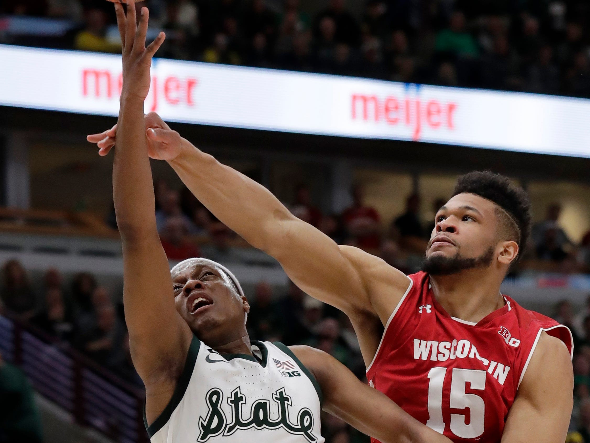 Michigan State's Cassius Winston (5) shoots against Wisconsin's Charles Thomas IV (15) during the second half of an NCAA college basketball game in the semifinals of the Big Ten Conference tournament, Saturday, March 16, 2019, in Chicago.
