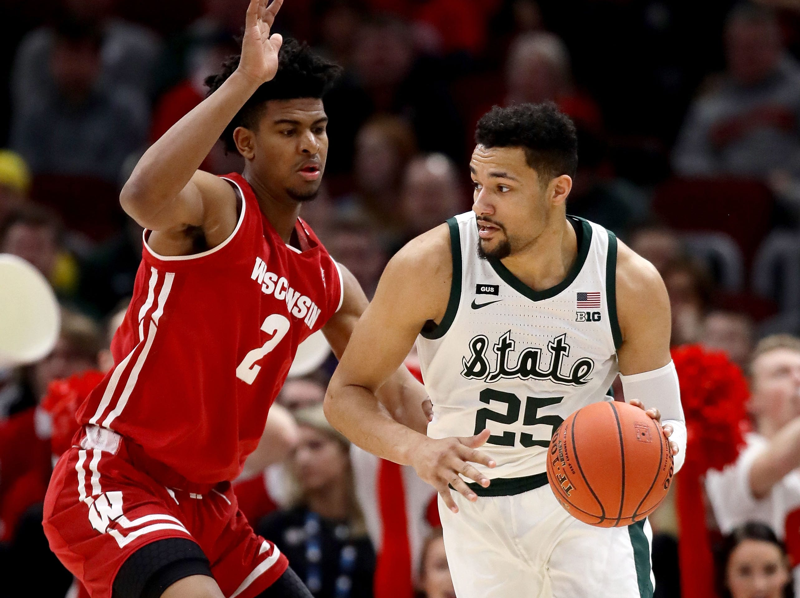 Kenny Goins #25 of the Michigan State Spartans dribbles the ball while being guarded by Aleem Ford #2 of the Wisconsin Badgers in the first half during the semifinals of the Big Ten Basketball Tournament at the United Center on March 16, 2019 in Chicago, Illinois.