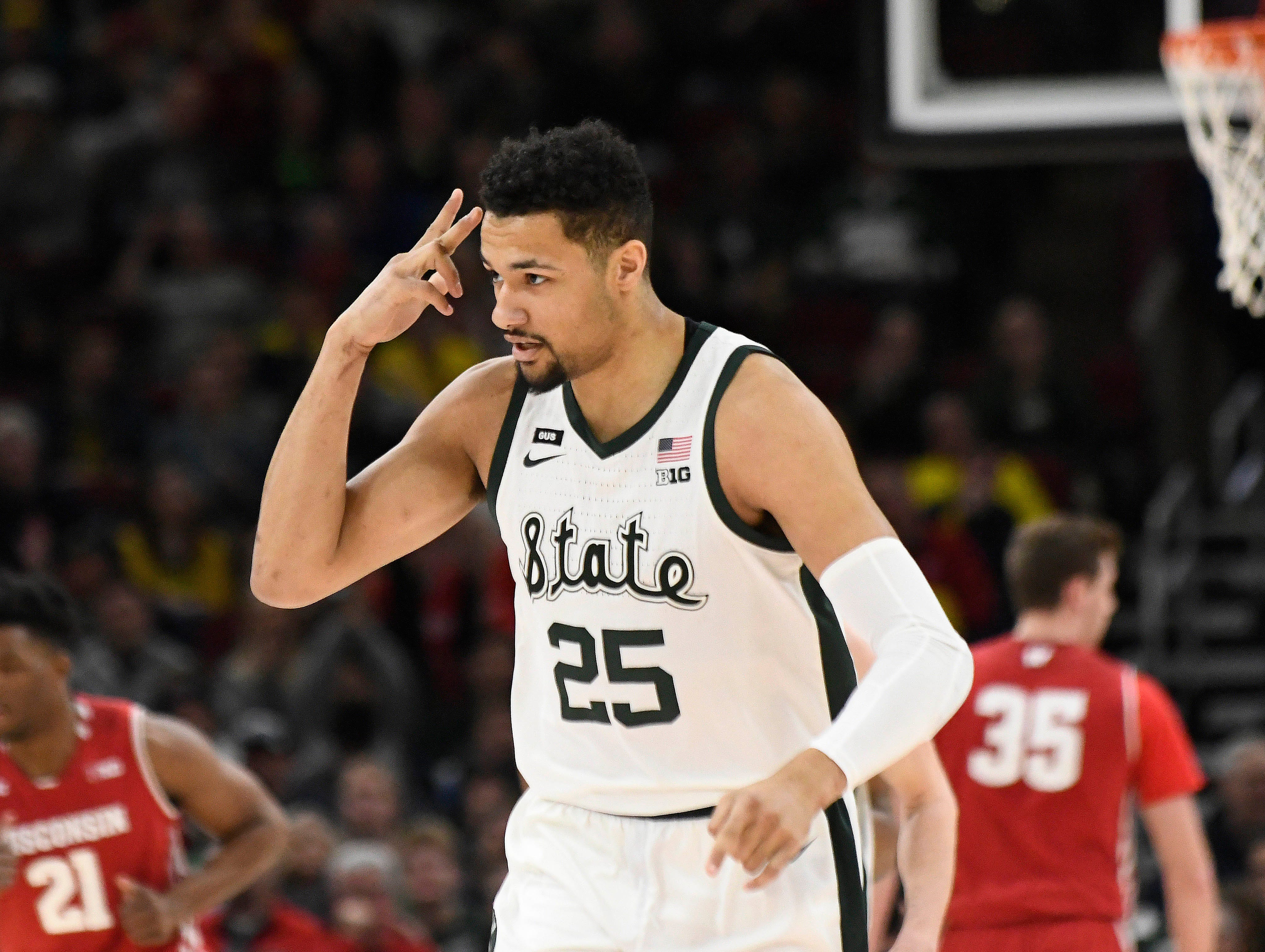 Michigan State Spartans forward Kenny Goins (25) celebrates after scoring against the Wisconsin Badgers during the first half in the Big Ten conference tournament at United Center.