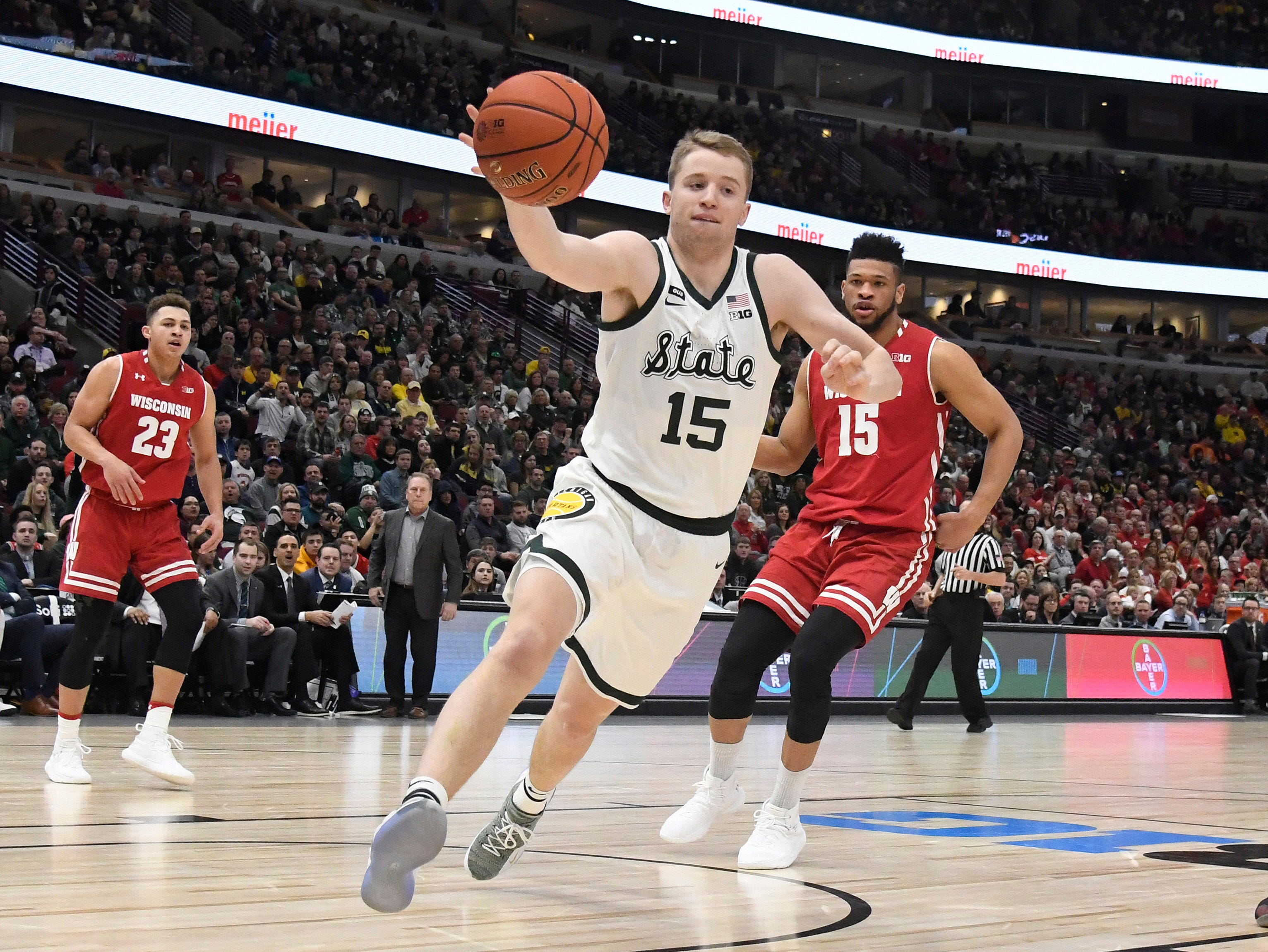 Michigan State Spartans forward Thomas Kithier (15) grabs a loose ball against the Wisconsin Badgers during the second half in the Big Ten conference tournament at United Center.