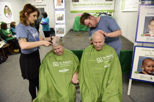 Melody and Richard Hensel, of Lexington, have their hair shaved Friday for the St. Baldrick's foundation.