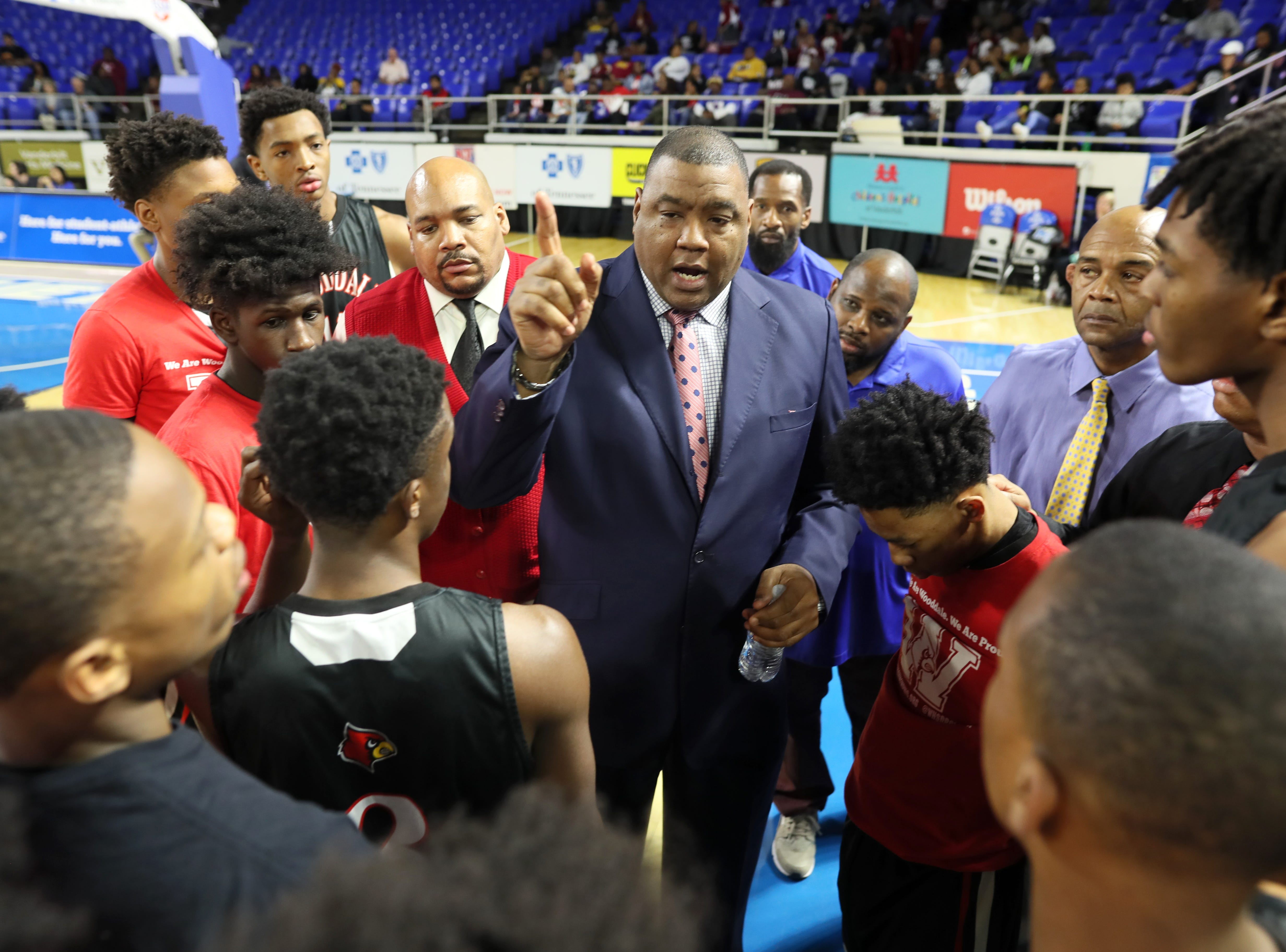 Wooddale Head Coach Keelon Lawson talks to his team before they take on Fulton during the Class AA boys basketball state championship game at the Murphy Center in Murfreesboro, Tenn. on Saturday, March 16, 2019.