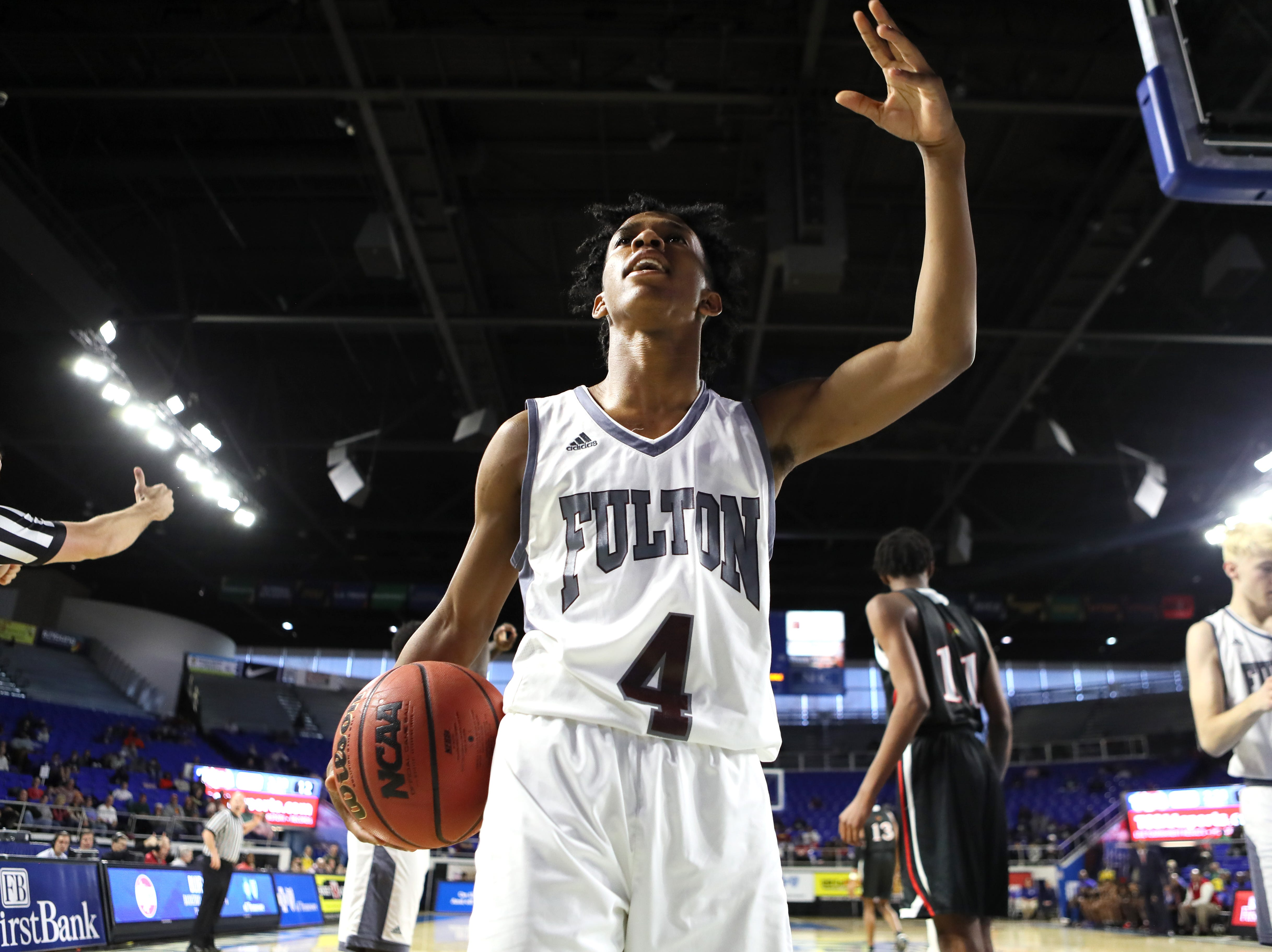Fulton's Edward Lacy celebrates a defensive stop against Wooddale during the Class AA boys basketball state championship game at the Murphy Center in Murfreesboro, Tenn. on Saturday, March 16, 2019.
