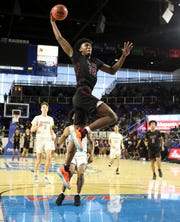 Memphis East's James Wiseman dunks the ball on a fast break against Bearden during the Class AAA boys basketball state championship game at the Murphy Center in Murfreesboro, Tenn. on Saturday, March 16, 2019.