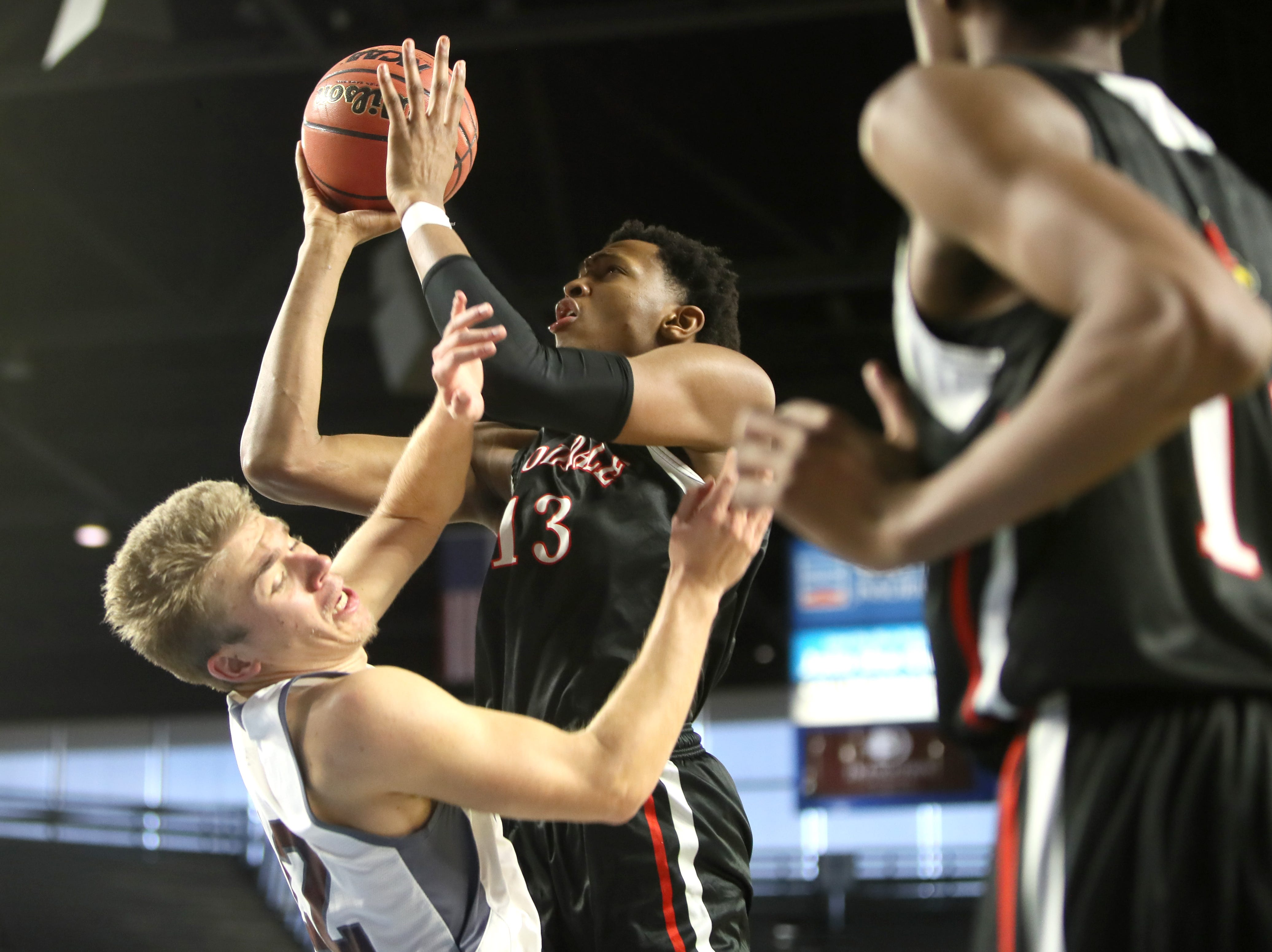 Wooddale's Chandler Lawson shoots the ball over and is fouled by Fulton's Deshaun Page during the Class AA boys basketball state championship game at the Murphy Center in Murfreesboro, Tenn. on Saturday, March 16, 2019.