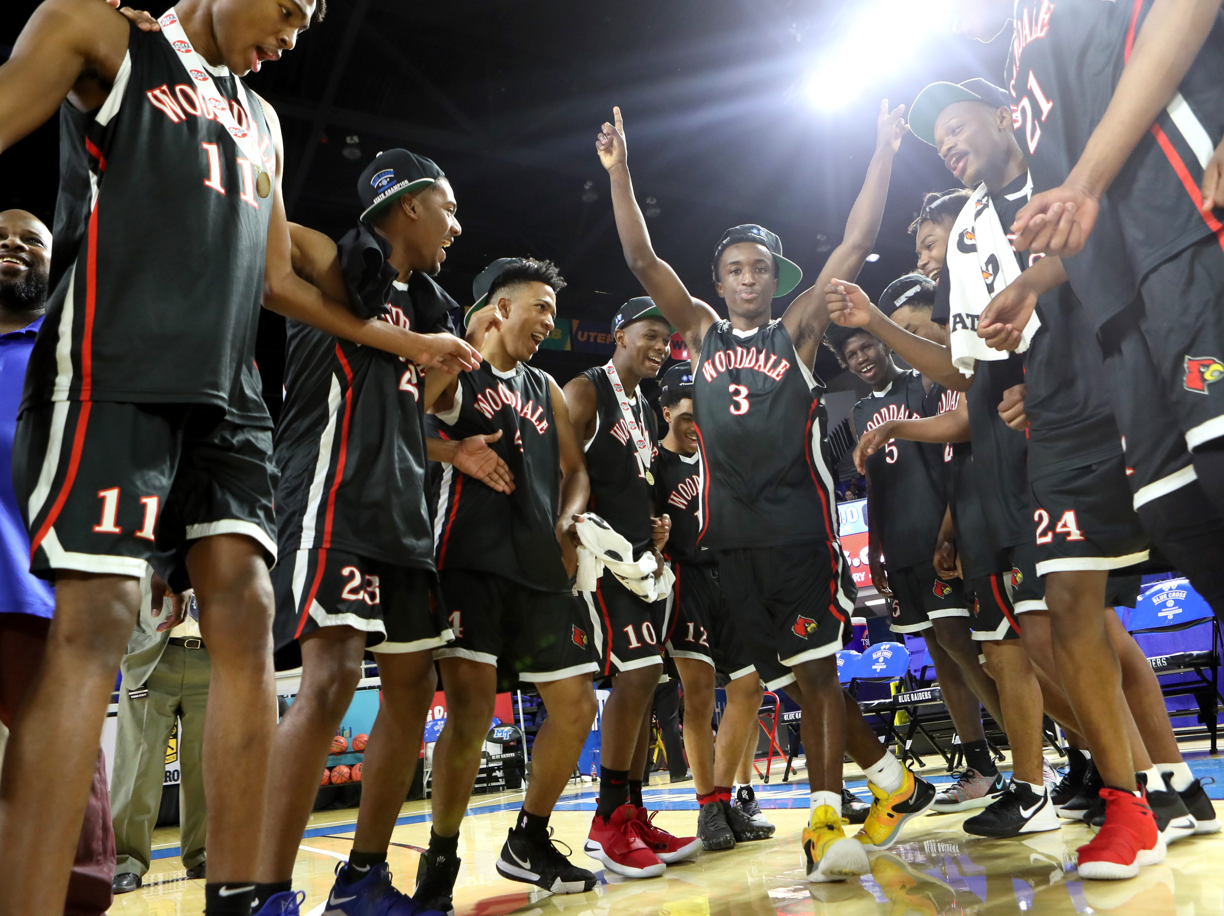 Wooddale's Alvin Miles, center, dances with his teammates as they celebrate their Class AA boys basketball state championship win Fulton at the Murphy Center in Murfreesboro, Tenn. on Saturday, March 16, 2019.