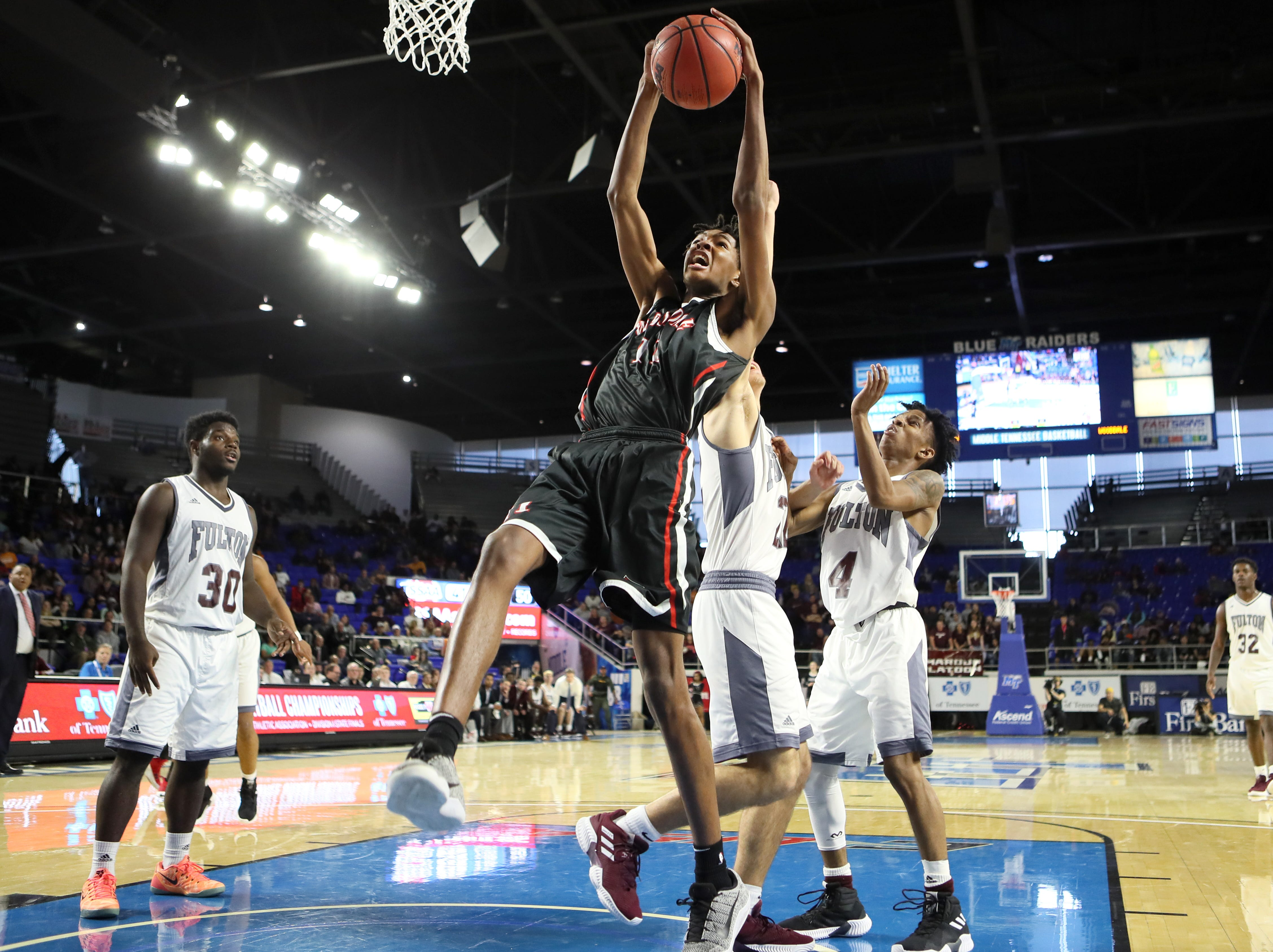 Wooddale's Johnathan Lawson grabs a rebound over Fulton during the Class AA boys basketball state championship game at the Murphy Center in Murfreesboro, Tenn. on Saturday, March 16, 2019.