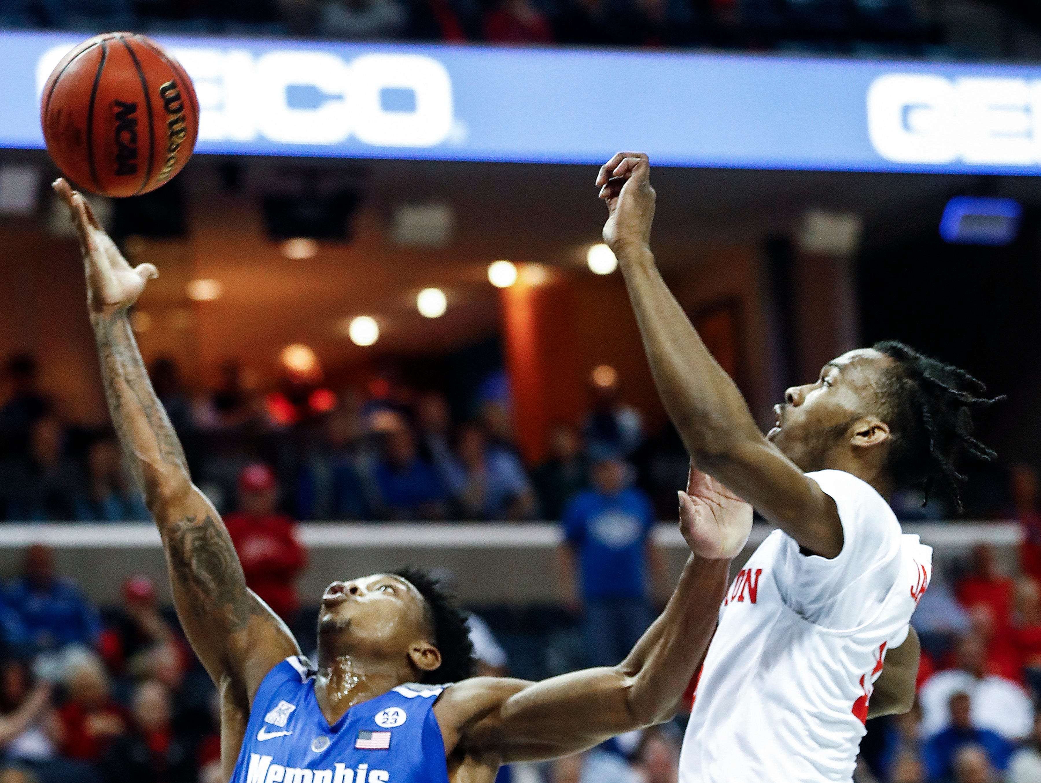 Memphis guard Kareem Brewton Jr. (left) drive for a layup in front of Houston defender DeJon Jarreau (right) during action in their semifinal round AAC Tournament game at the FedExForum, Saturday, March 16, 2019.