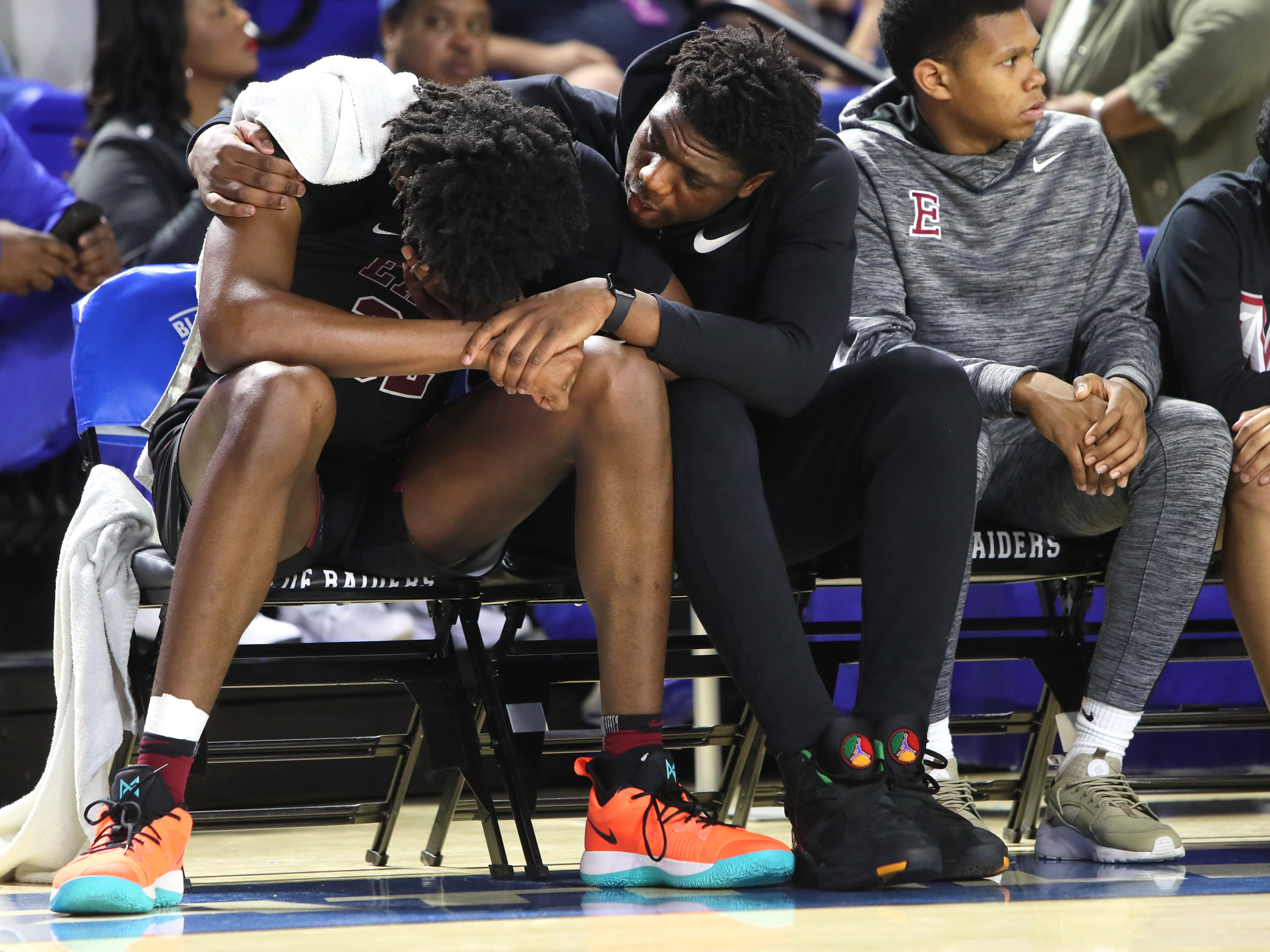 Memphis East's Malcolm Dandridge, right, holds James Wiseman as he shows his emotion while the Mustangs fall 83-68 to Bearden during the Class AAA boys basketball state championship game at the Murphy Center in Murfreesboro, Tenn. on Saturday, March 16, 2019.