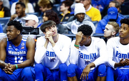 Memphis teammates (left to right) Victor Enoh, David Wingett, Ryan Boyce and Jayden Hardaway watch from the bench during a 61-58 loss to Houston in their semifinal round AAC Tournament game at the FedExForum, Saturday, March 16, 2019.