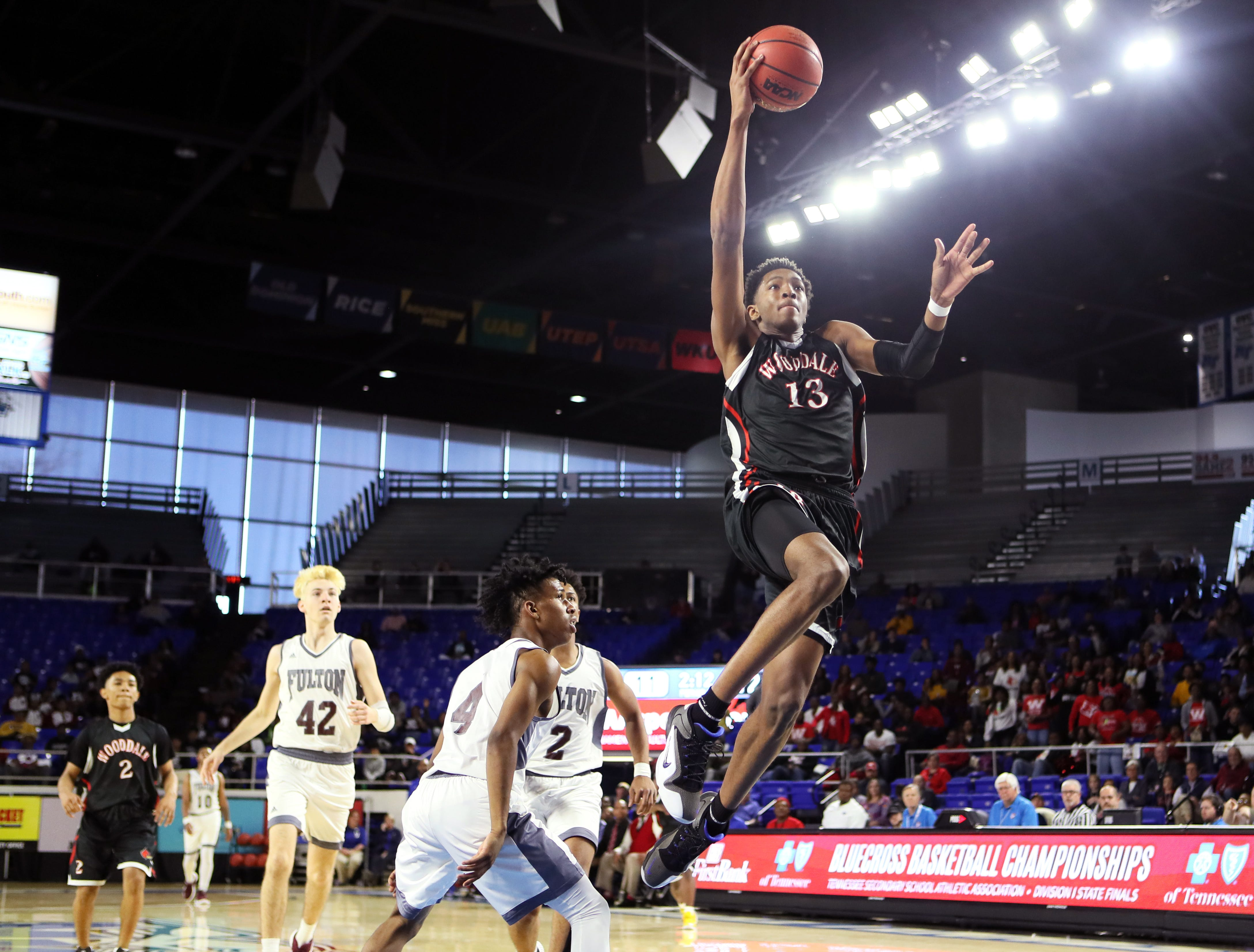 Wooddale's Chandler Lawson lays the ball up on a fast break against Fulton during the Class AA boys basketball state championship game at the Murphy Center in Murfreesboro, Tenn. on Saturday, March 16, 2019.
