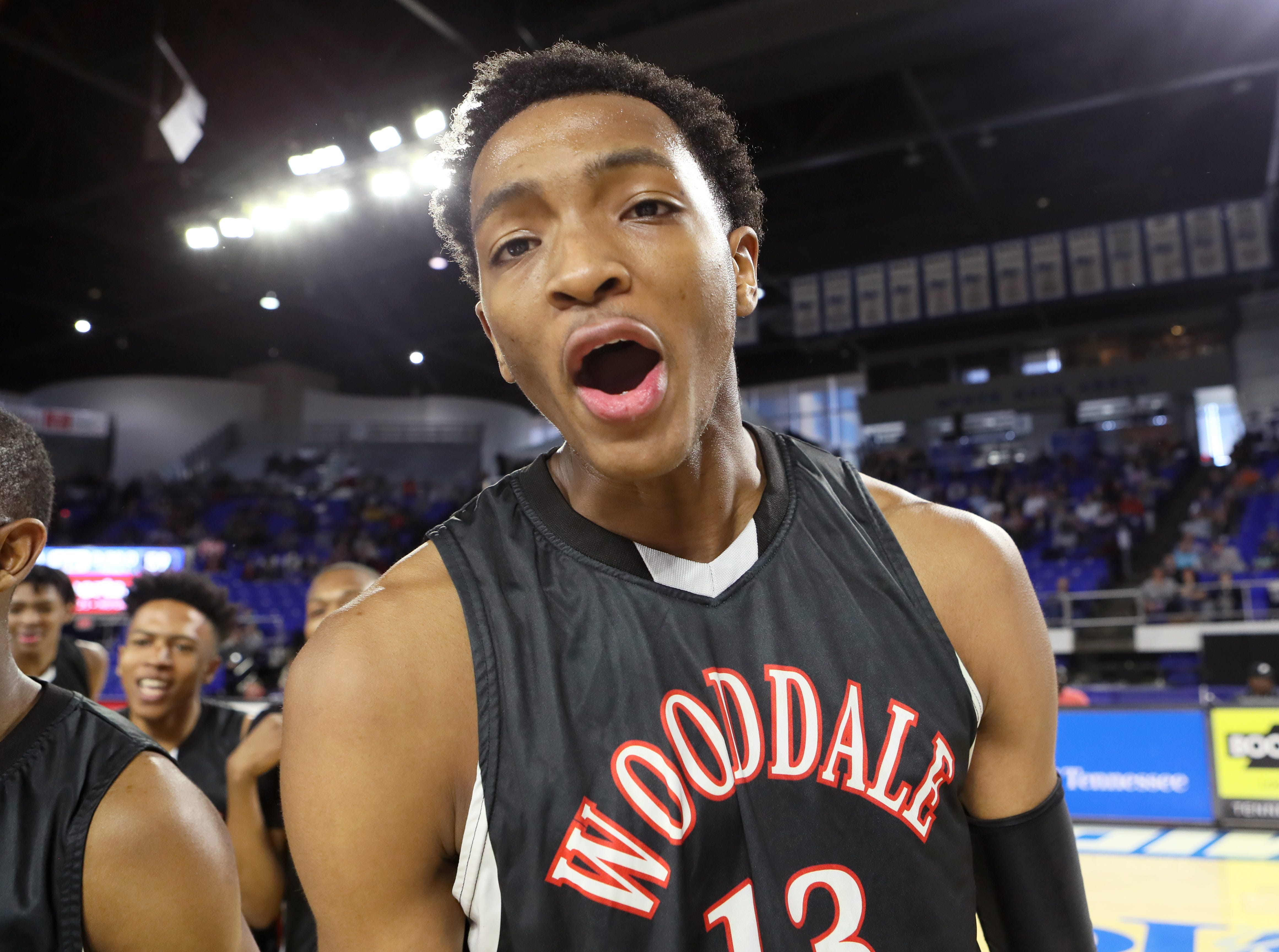 Wooddale's Chandler Lawson yells out in celebration of their 59-46 win over Fulton for the Class AA boys basketball state championship at the Murphy Center in Murfreesboro, Tenn. on Saturday, March 16, 2019.