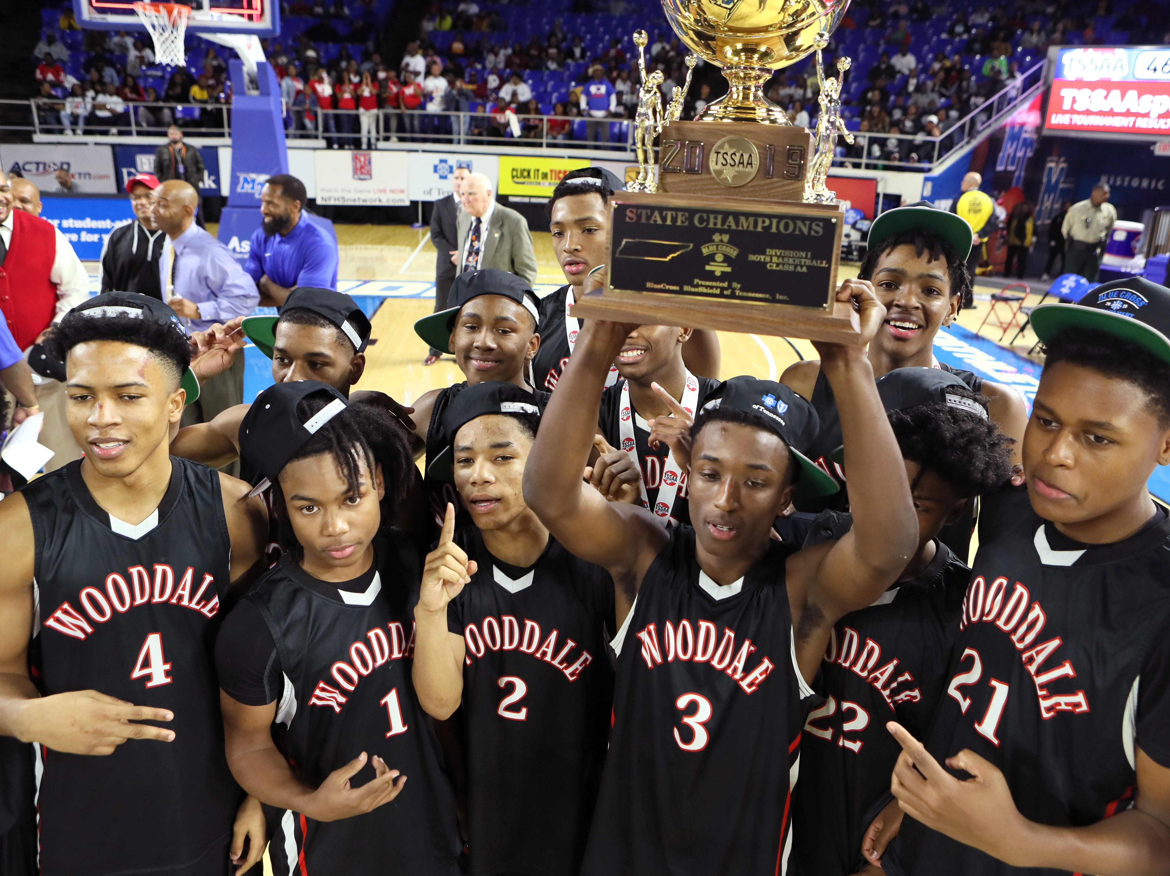 Wooddale celebrates their Class AA boys basketball state championship win Fulton at the Murphy Center in Murfreesboro, Tenn. on Saturday, March 16, 2019.