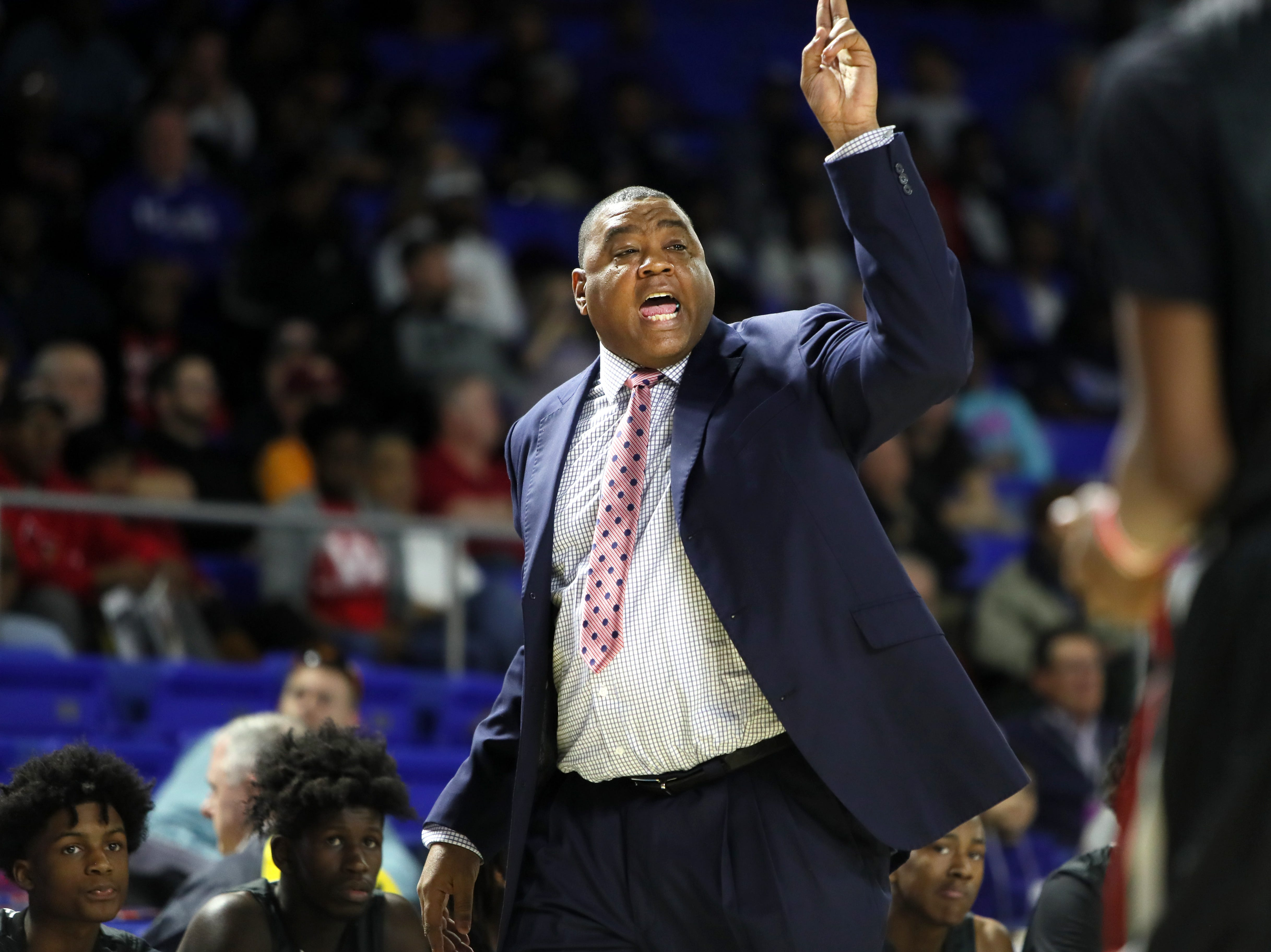 Wooddale Head Coach Keelon Lawson yells out to his team as they take on Fulton during the Class AA boys basketball state championship game at the Murphy Center in Murfreesboro, Tenn. on Saturday, March 16, 2019.