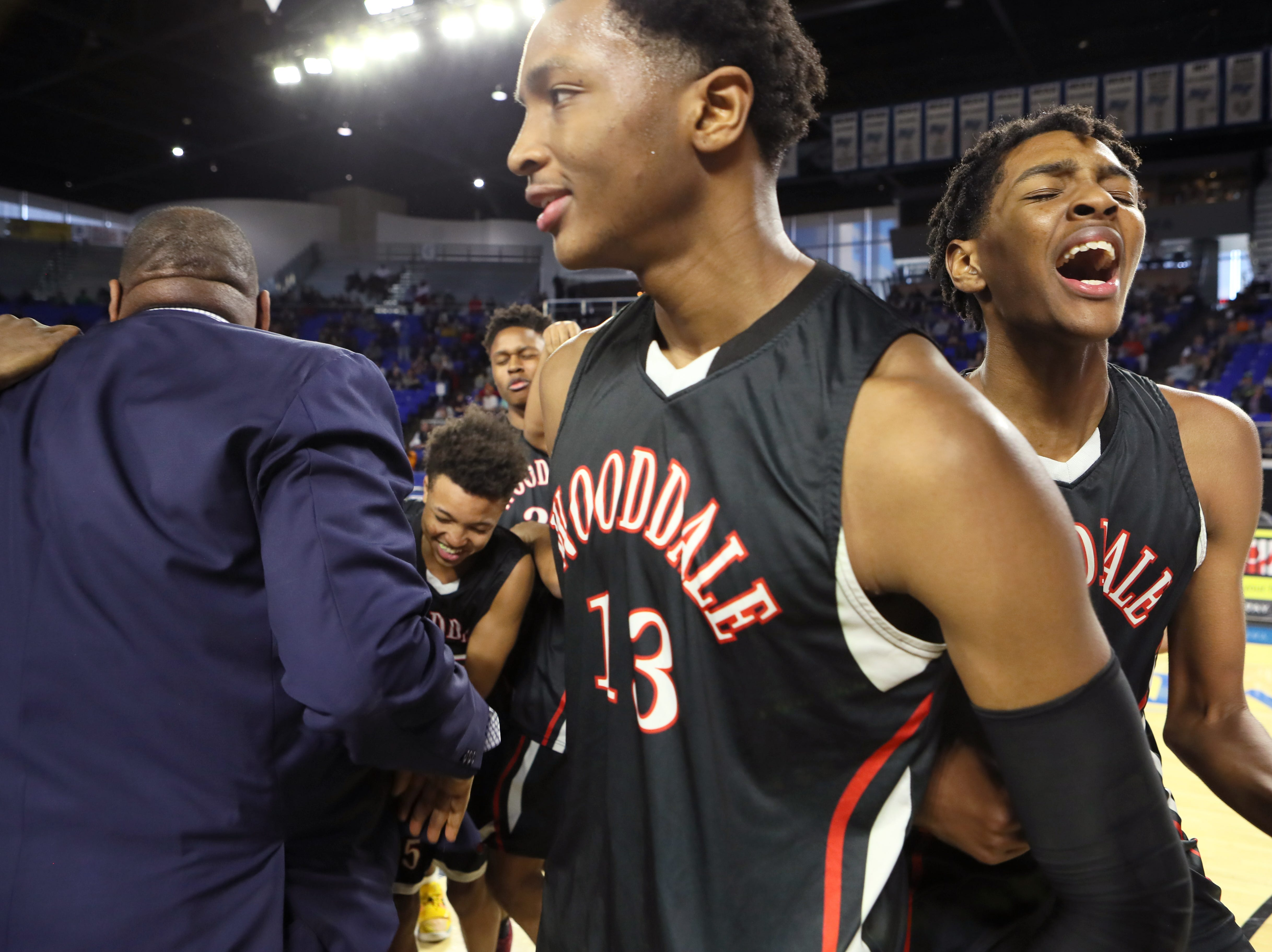 Wooddale's Chandler Lawson center, his brother Johnathan Lawson celebrate their 59-46 win over Fulton for the Class AA boys basketball state championship at the Murphy Center in Murfreesboro, Tenn. on Saturday, March 16, 2019.