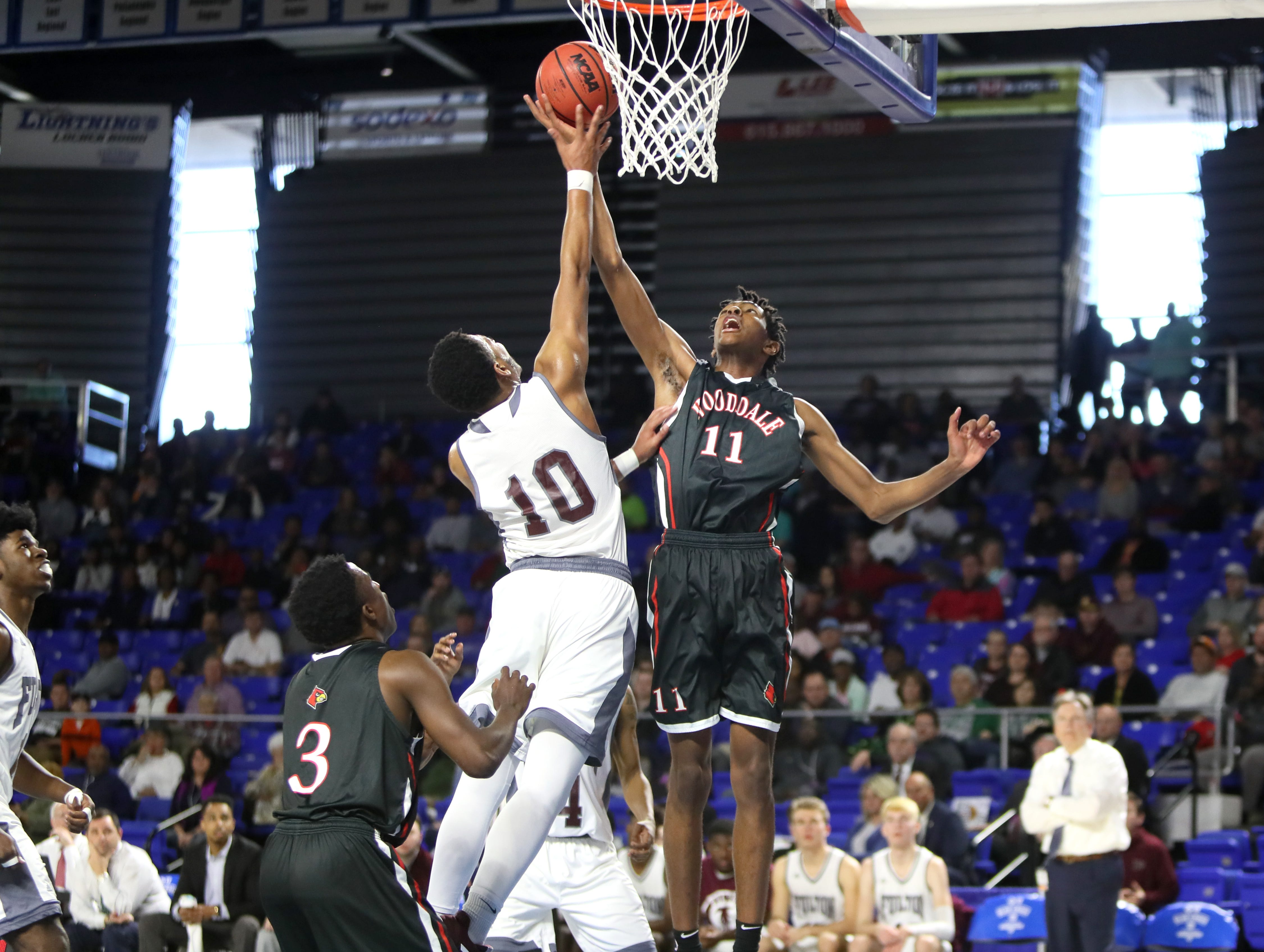 Wooddale's Johnathan Lawson shoots the ball over Fulton's Trey West during the Class AA boys basketball state championship game at the Murphy Center in Murfreesboro, Tenn. on Saturday, March 16, 2019.