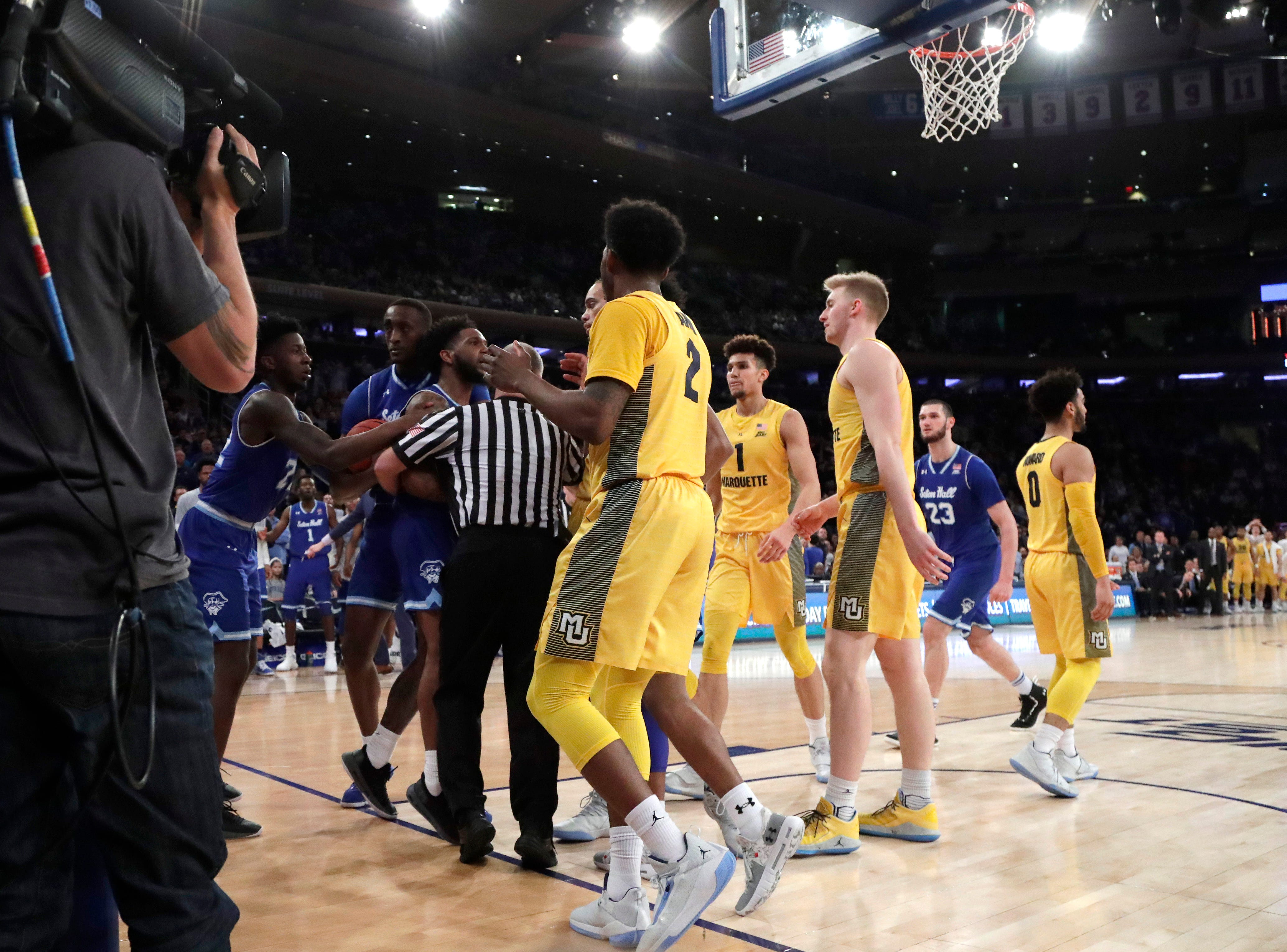 Marquette and Seton Hall players need to be separated during an altercation. The game featured 46 fouls and 85 free throws.