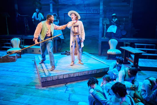 "DiMonte Henning and Luke Brotherhood seek their freedom on a raft in ""Big River,"" performed by First Stage."