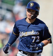 Brewers second baseman Keston Hiura runs the bases after hitting a home run against the Indians during a spring training game March 13. Hiura is the Brewers' top prospect entering the 2019 season.
