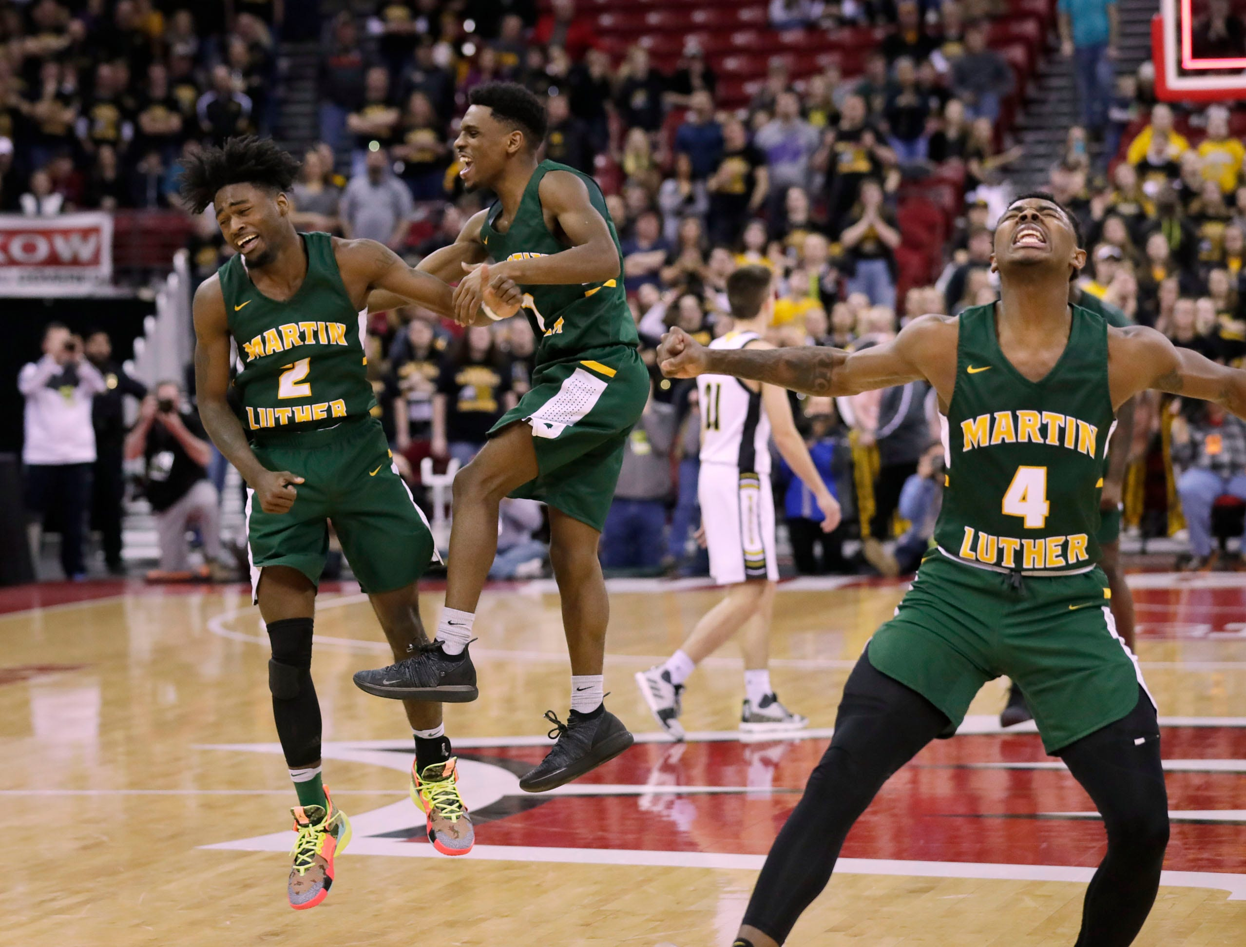 Martin Luther players react at the buzzer as Martin Luther defeats Waupun, 58-49, during the Division 3 championship game at the WIAA 2019 boys basketball state tournament in Madison, Wisconsin, Saturday, March 16, 2019.  Rick Wood/Milwaukee Journal Sentinel