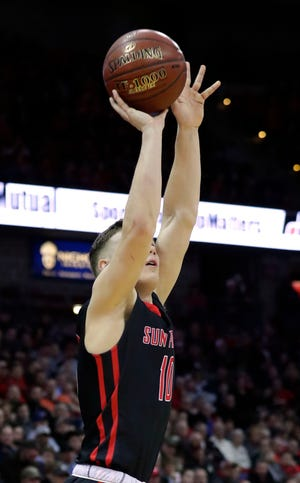 Sun Prairie's Colin Schaefer shoots a 3-pointer during the WIAA state basketball tournament.