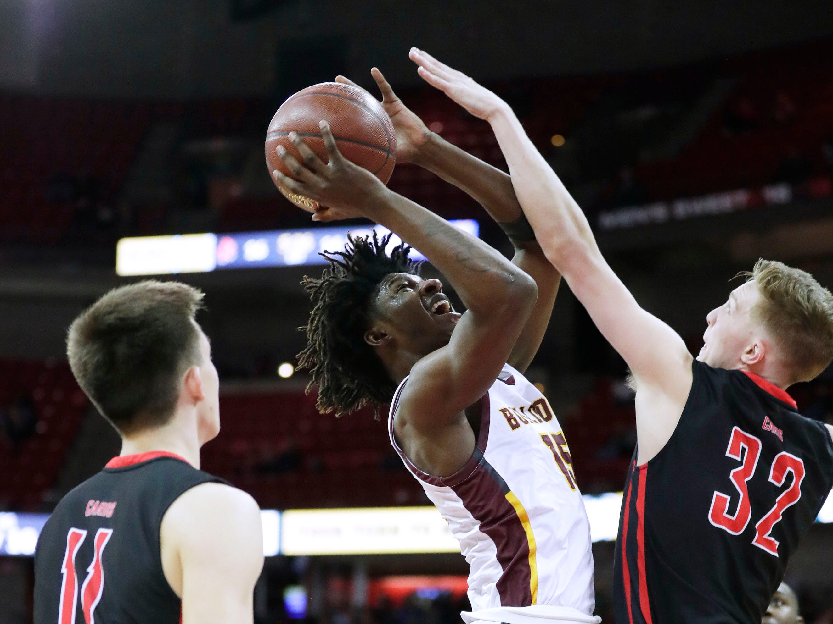 West Allis Central's Shilo Bowles gets a shot off over Sun Prairie's Alex Voight during the Division 1 semifinal game Friday night.