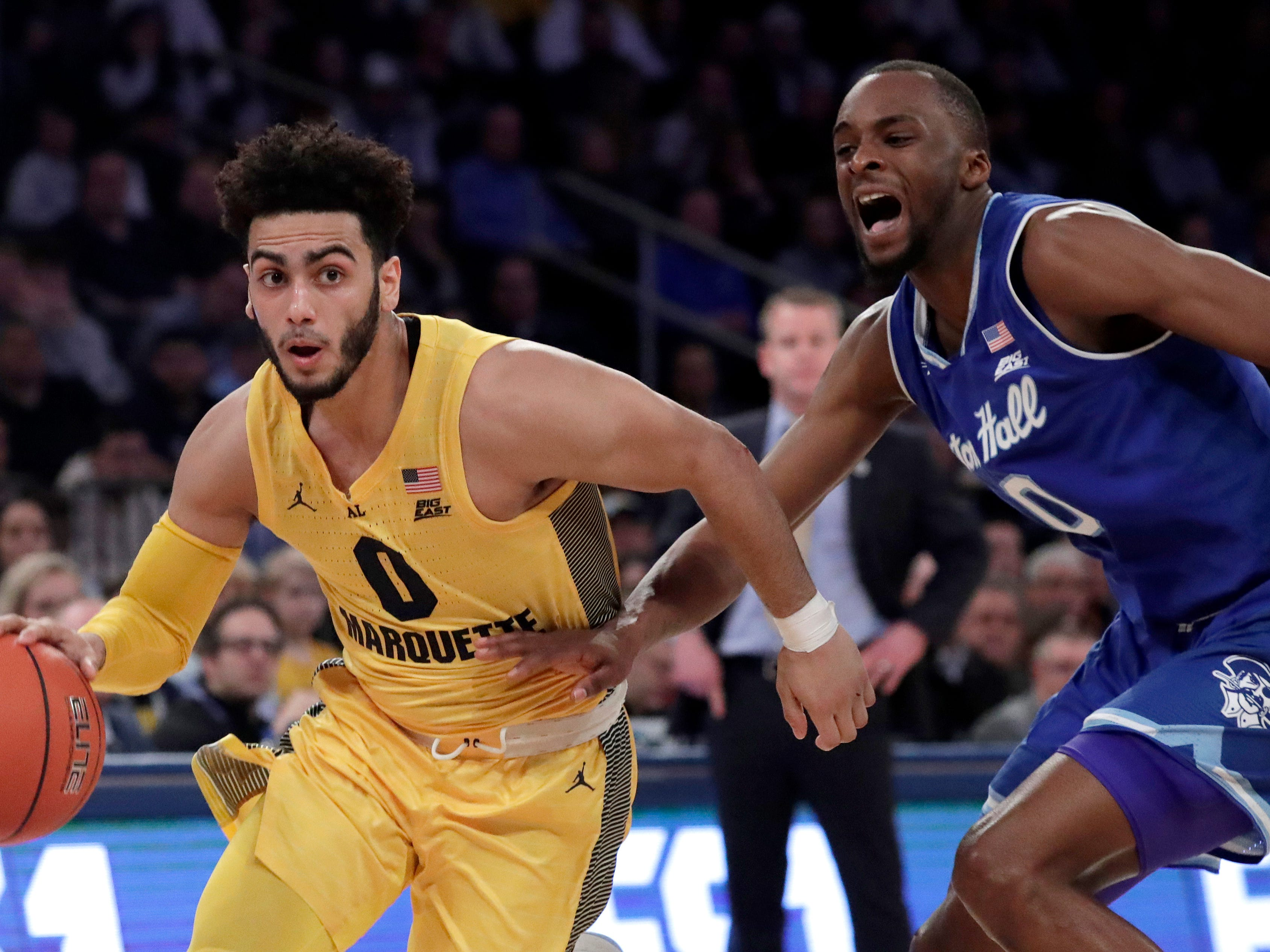 Marquette guard Markus Howard drives past Seton Hall guard Quincy McKnight.
