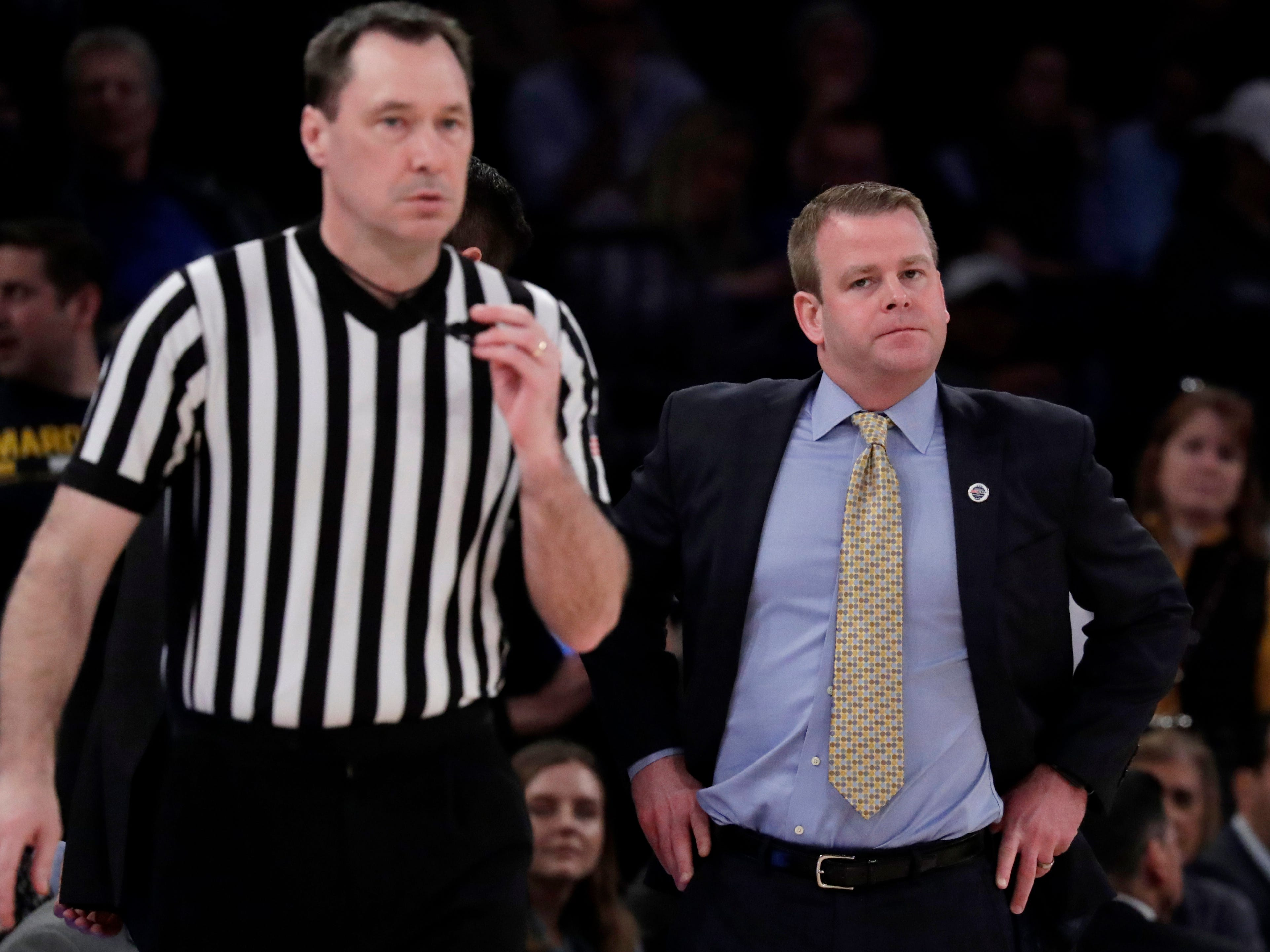 Marquette head coach Steve Wojciechowski  looks in the direction of official James Breeding. The two teams combined for 46 fouls and 85 free throws.