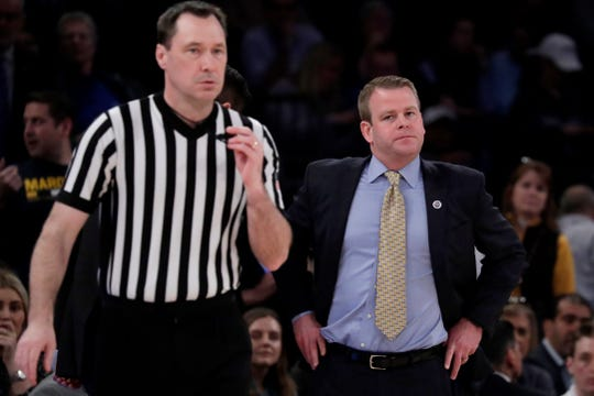 Marquette head coach Steve Wojciechowski,  looks in the direction of official James Breeding after not being happy with a call. Marquette and Seton Hall were whistled for a combined 46 fouls.
