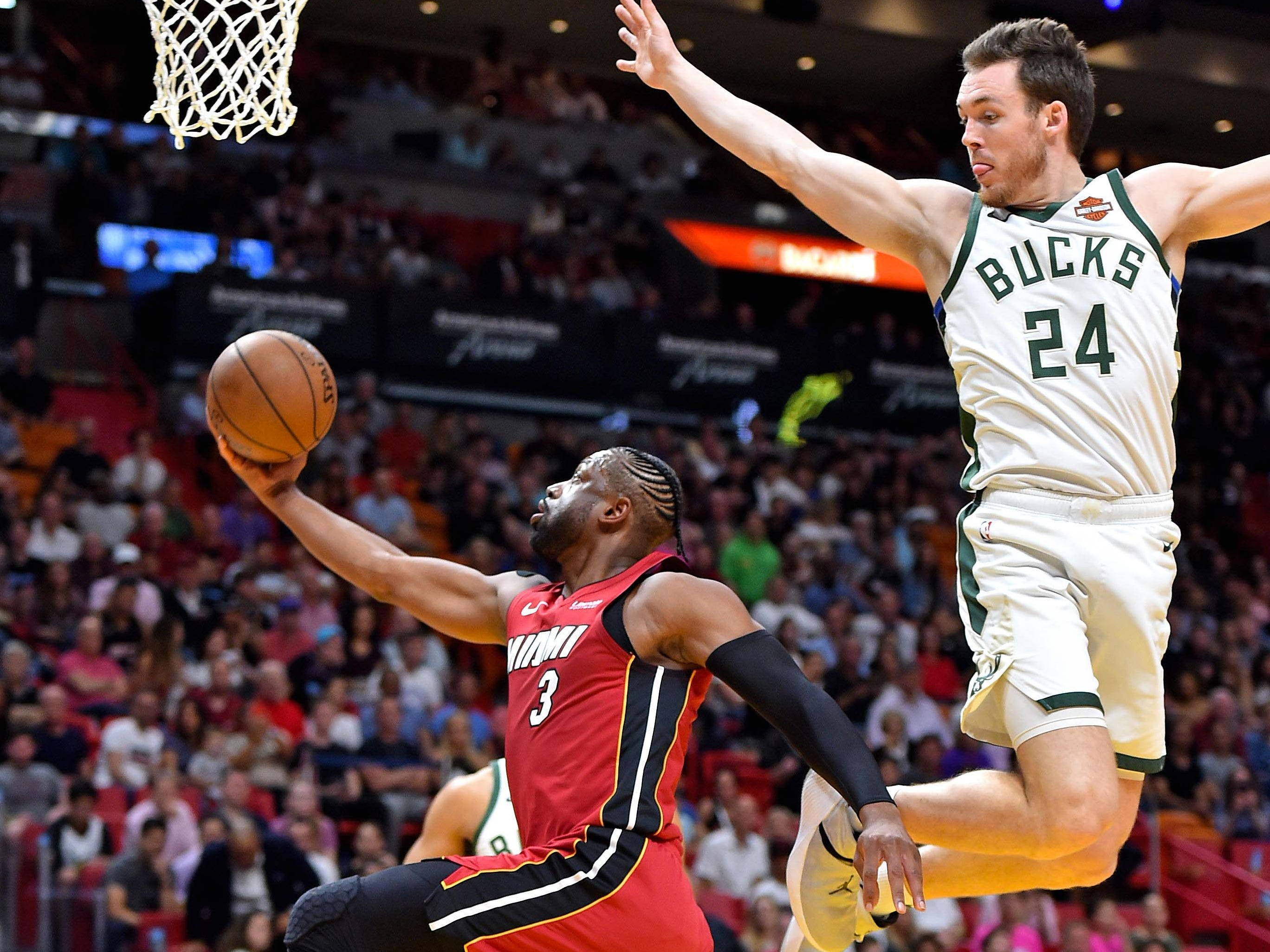 Heat guard Dwyane Wade drives to the basket ahead of Pat Connaughton.