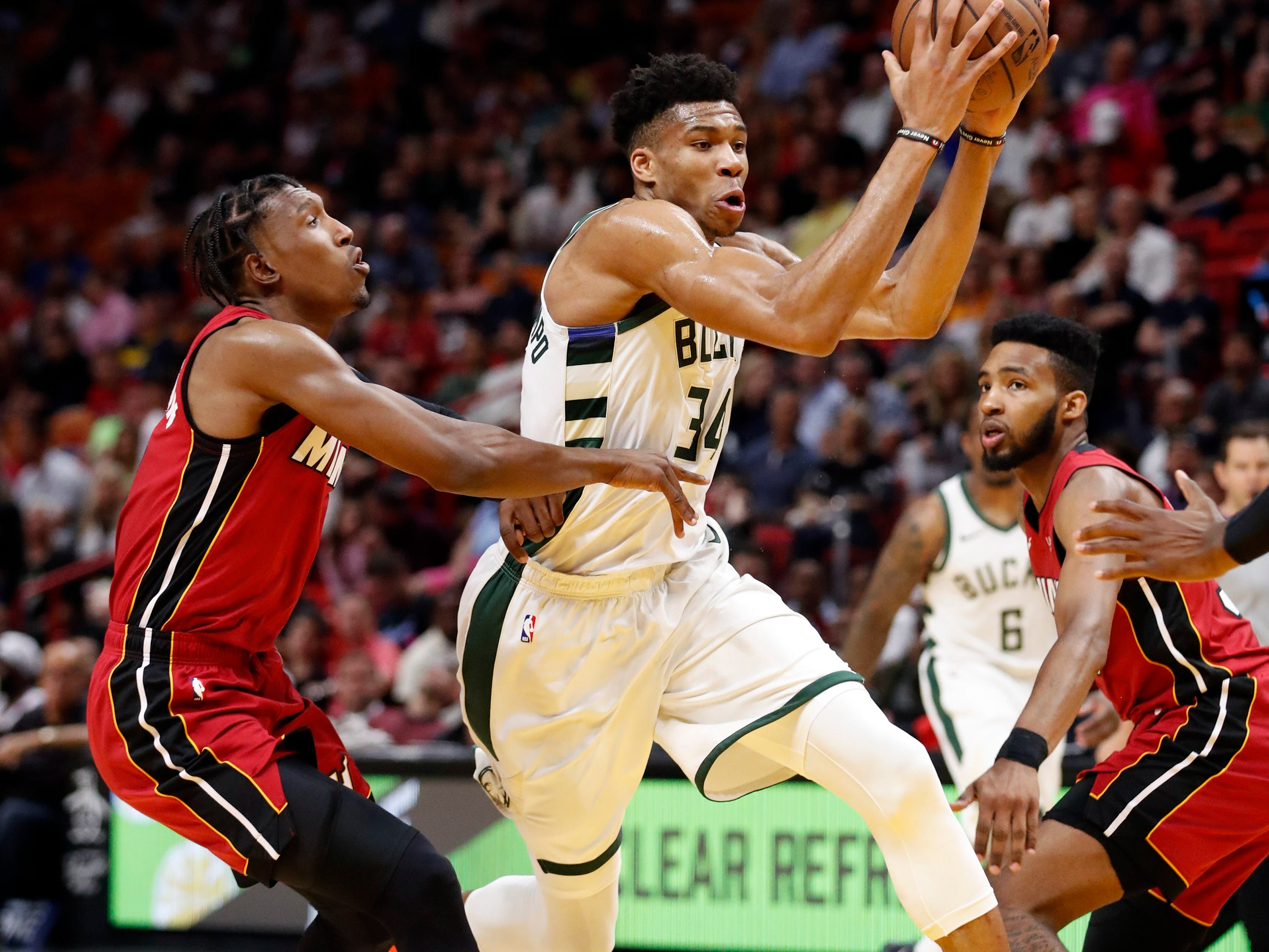 Giannis Antetokounmpo splits the defense and drives to the basket Friday night.