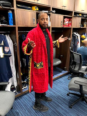 """Milwaukee Brewers reliever Jeremy Jeffress strolled into the clubhouse  wearing a red Versace robe over his street clothes Saturday. """"Spa day,"""" he said."""