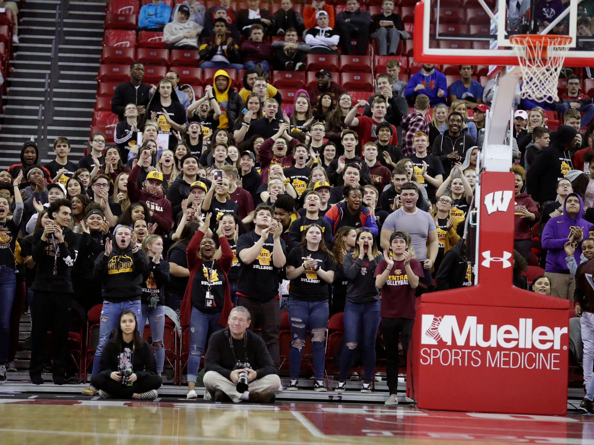 West Allis Central students enjoy the WIAA state tournament action.