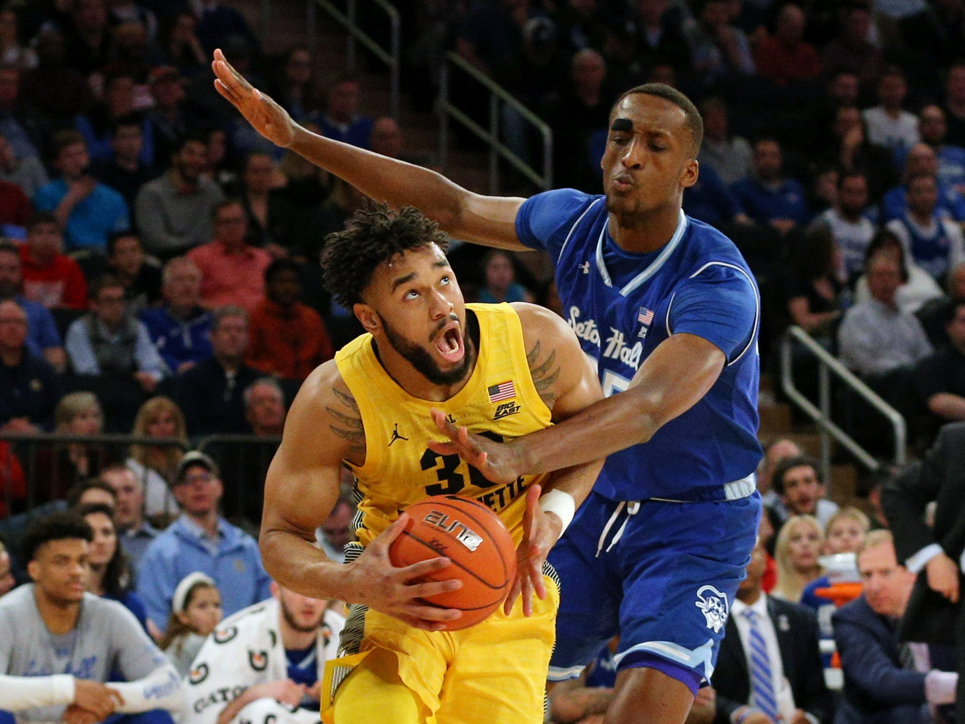 Marquette Golden Eagles forward Ed Morrow is fouled as he drives by Seton Hall's Romaro Gill.