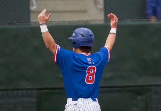 Louisiana Tech's Taylor Young (8) pumps up the crowd after sliding in for a score in the bottom of the second inning during the game against University of Southern Mississippi at J.C. Love field in Ruston, La. on March 15.